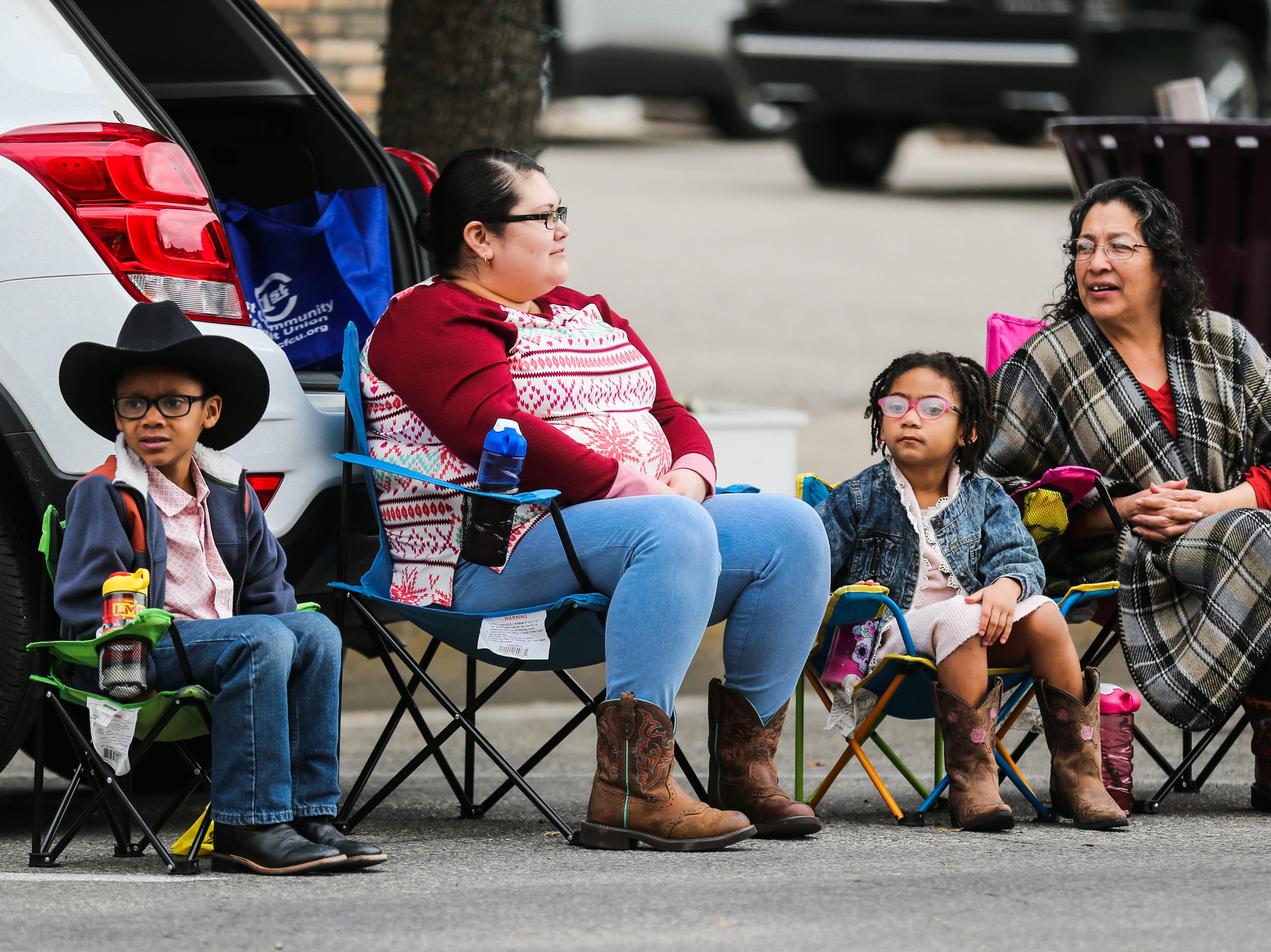 Spectators wait for paraders to make their way down the street during the San Angelo Stock Show and Rodeo Parade to start Saturday, Feb. 2, 2019, in downtown San Angelo.