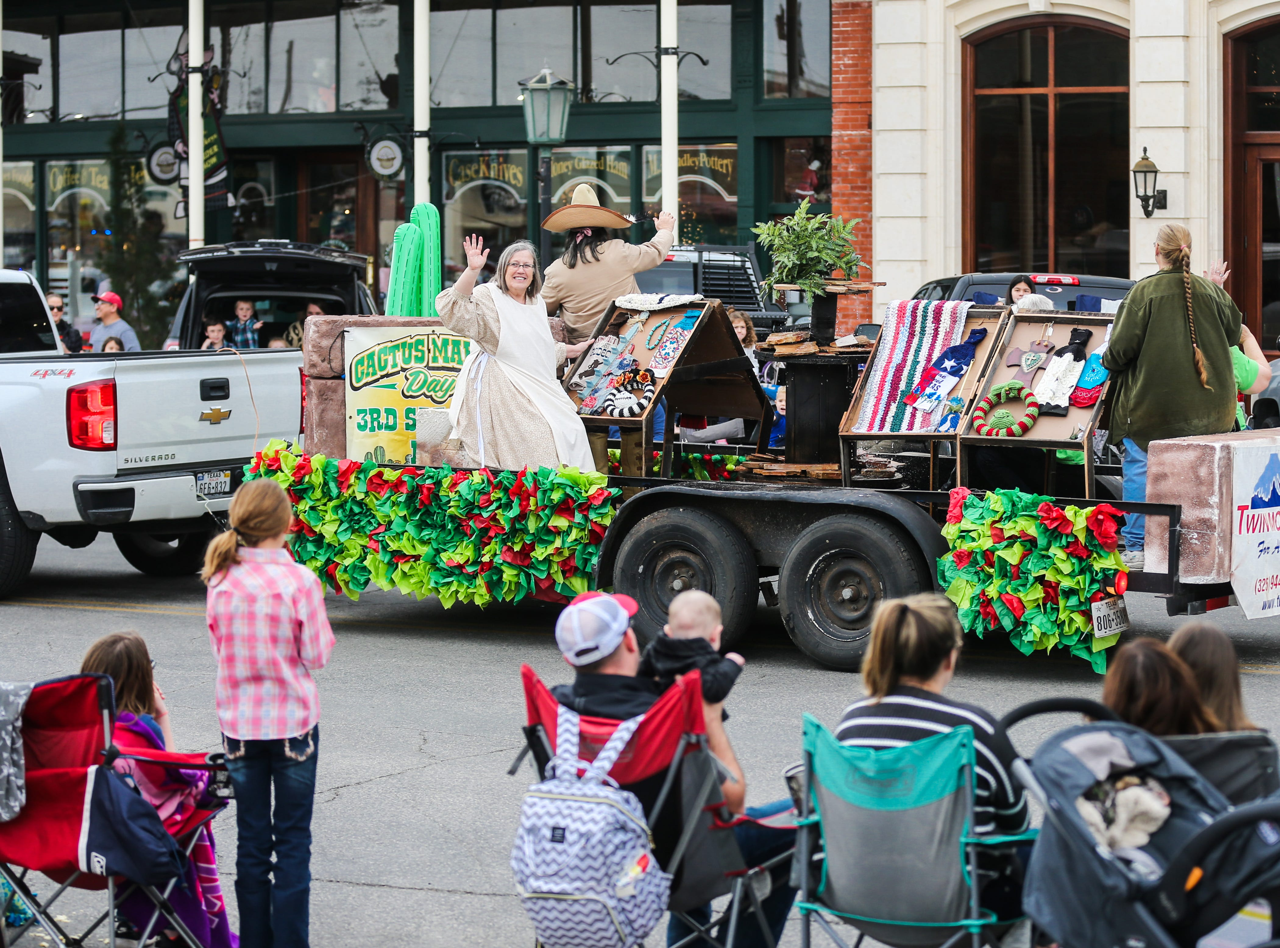 Parade participants wave to the crowd during the San Angelo Stock Show and Rodeo Parade to start Saturday, Feb. 2, 2019, in downtown San Angelo.