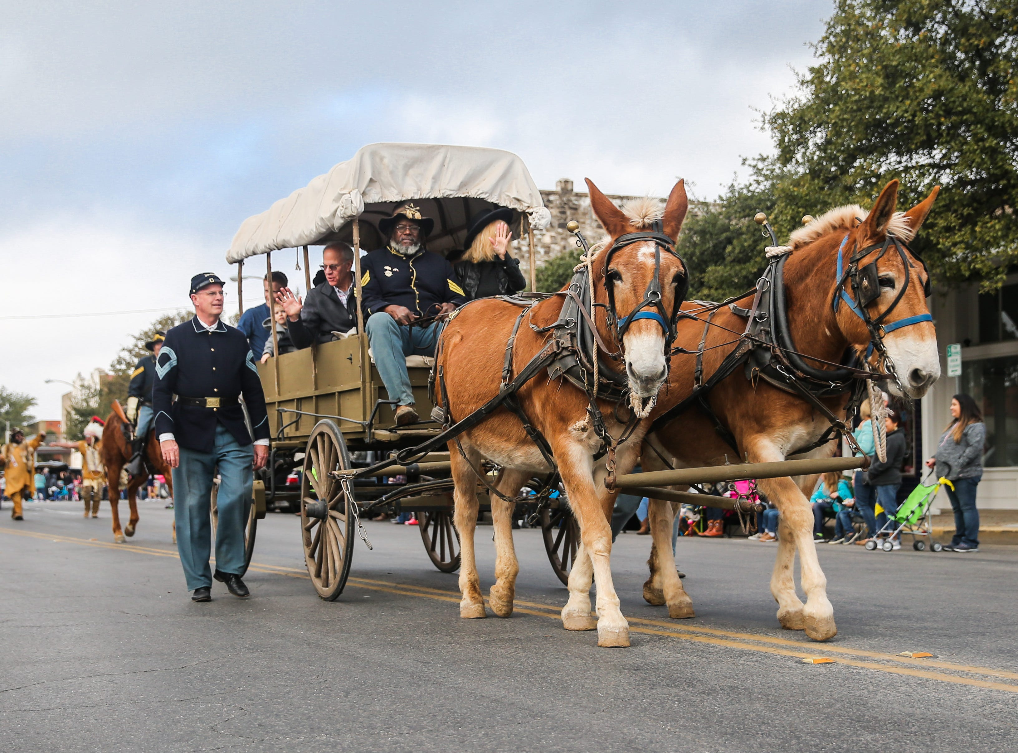 Fort Concho reenactors make their way down Concho Avenue during the San Angelo Stock Show and Rodeo Parade to start Saturday, Feb. 2, 2019, in downtown San Angelo.
