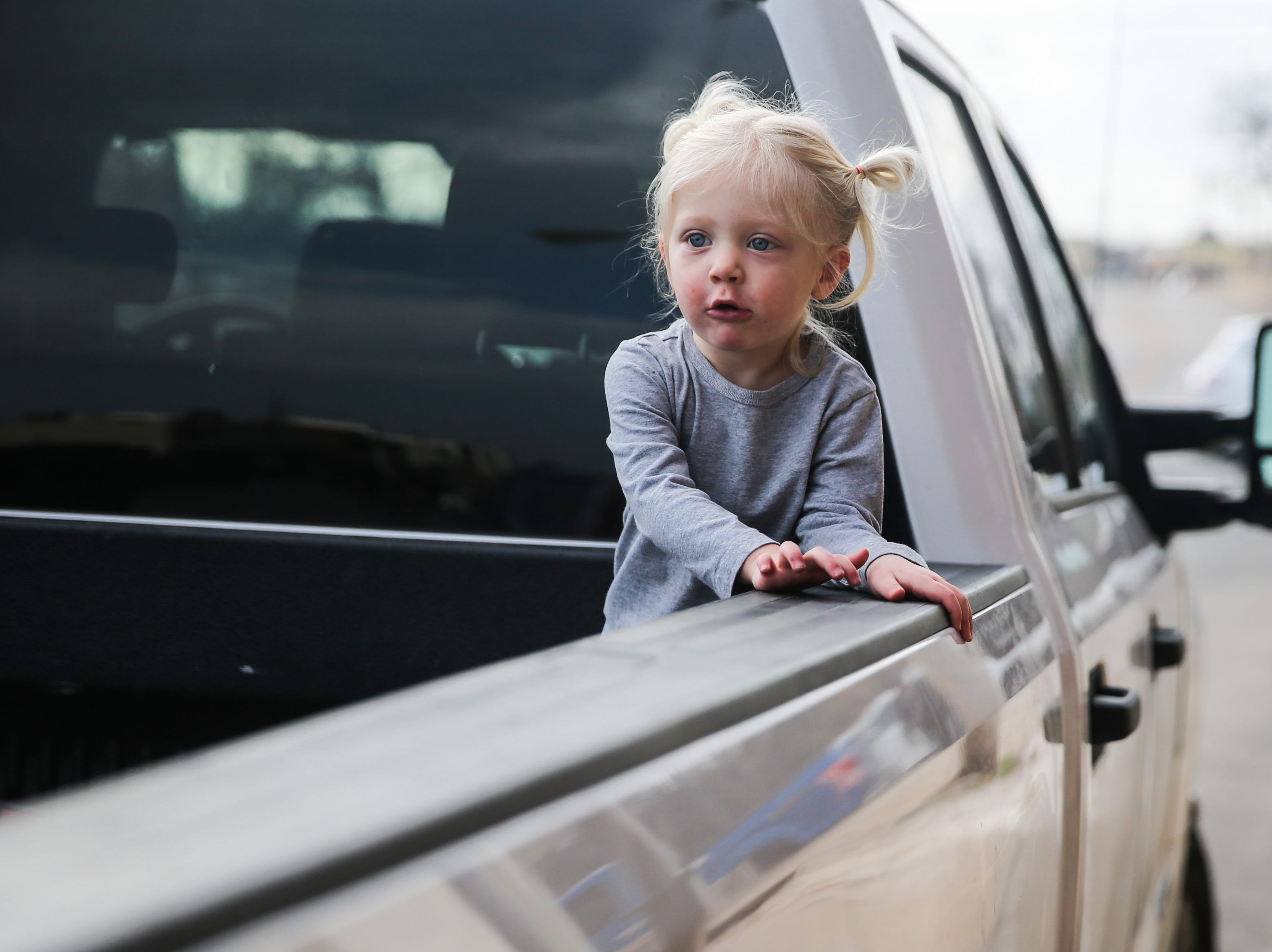 Jesse Rose Clem, 2, waits for the San Angelo Stock Show and Rodeo Parade to start Saturday, Feb. 2, 2019, in downtown San Angelo.