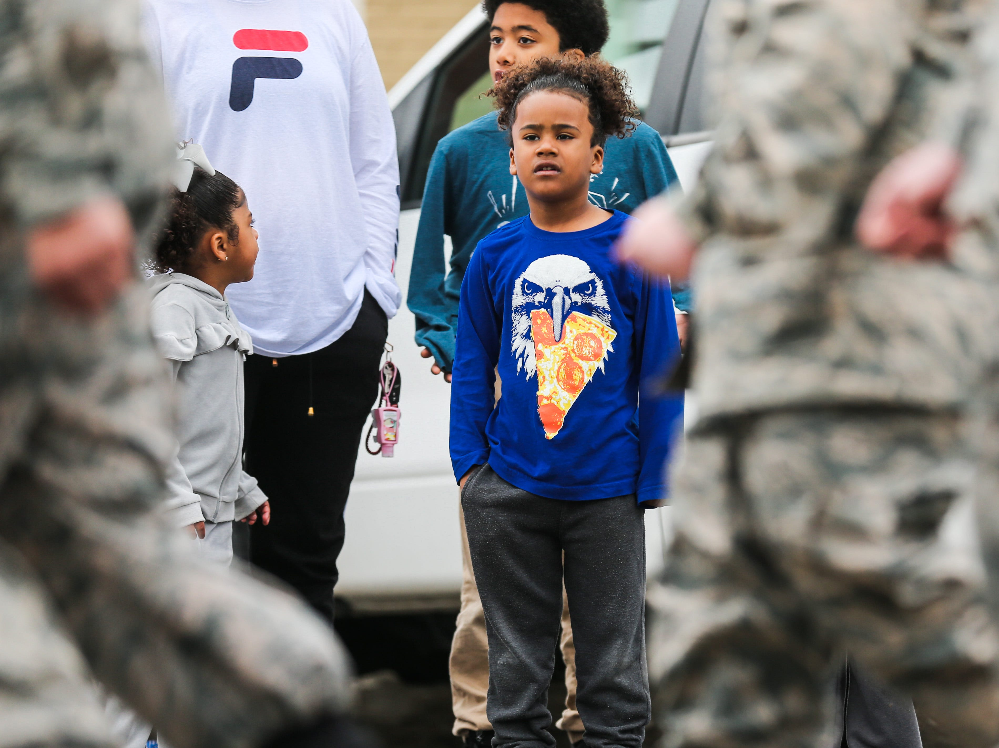 Spectators watch ROTC members march during the San Angelo Stock Show and Rodeo Parade to start Saturday, Feb. 2, 2019, in downtown San Angelo.