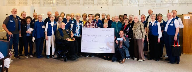 Members of Baptist Retirement Community's Auxiliary group donated $300,000 toward a strategic plan and renovation efforts at Baptist Retirement Community to Executive Director Aaron Hargett.