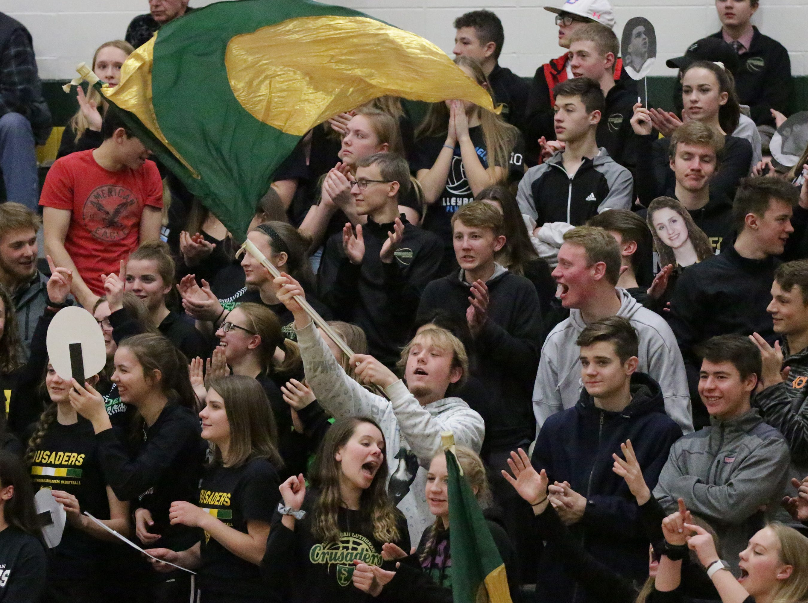 Sheboygan Lutheran fans cheer their team during action with Manitowoc Lutheran, Friday, February 1, 2019, in Sheboygan, Wis.