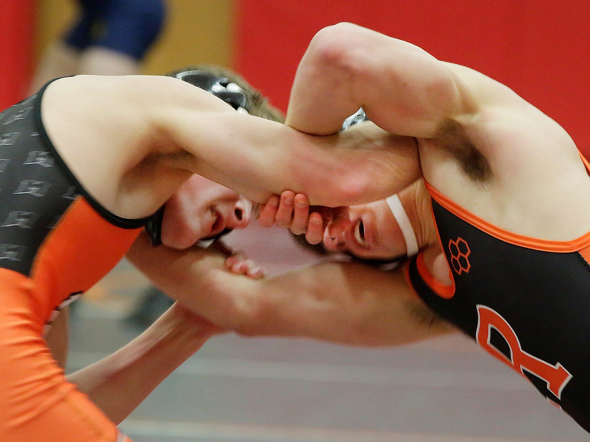 Cedar Grove Tyler Kowalkowiski, right, wrestles Michicot's Joe Desotelle in a 145-pound match, Saturday, February 2, 2019, in Oostburg, Wis.