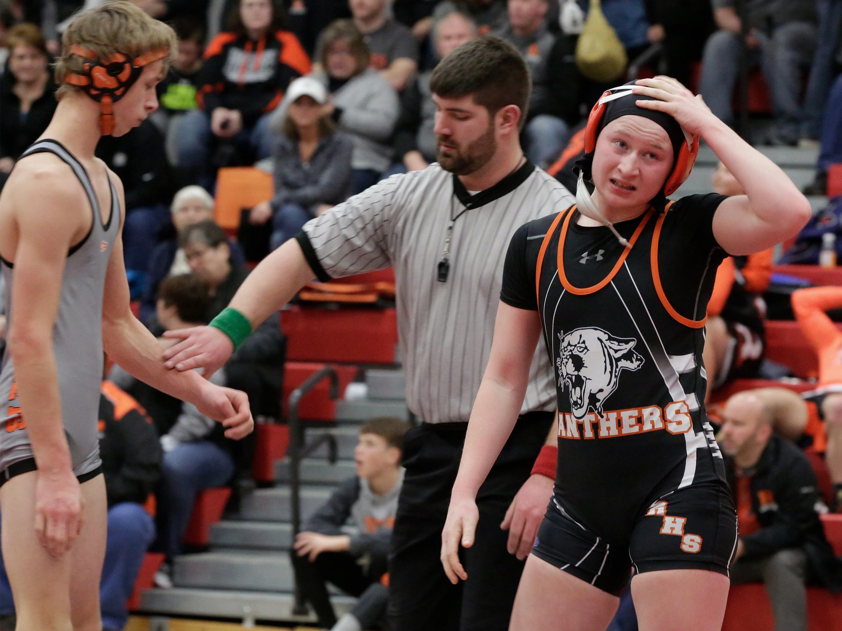 Reedsville's Erin Braun, right, reacts to losing a152-pound match with Cedar Grove-Belgium's Dylan Teunissen, Saturday, February 2, 2019, in Oostburg, Wis.