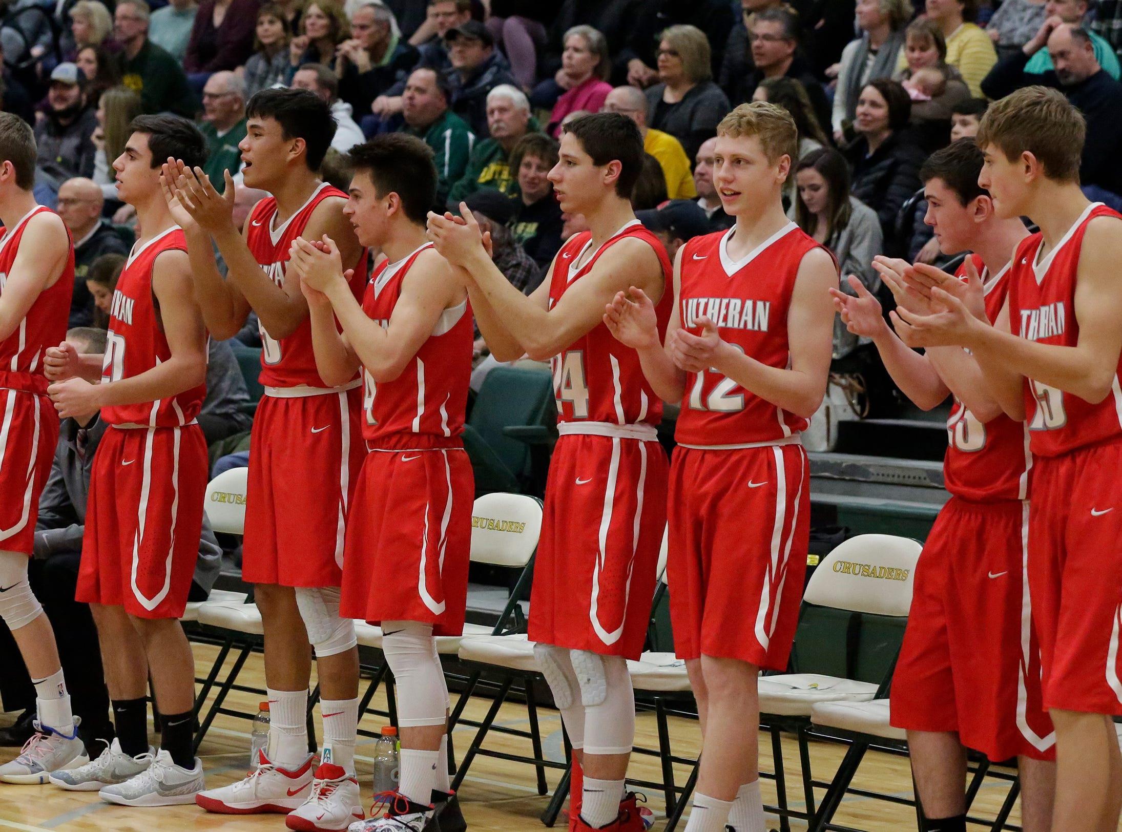 Manitowoc Lutheran players cheer their team mates during action with Sheboygan Lutheran, Friday, February 1, 2019, in Sheboygan, Wis.