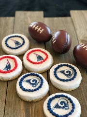 Eileen's Colossal Cookies' Patriots and Rams cookies.
