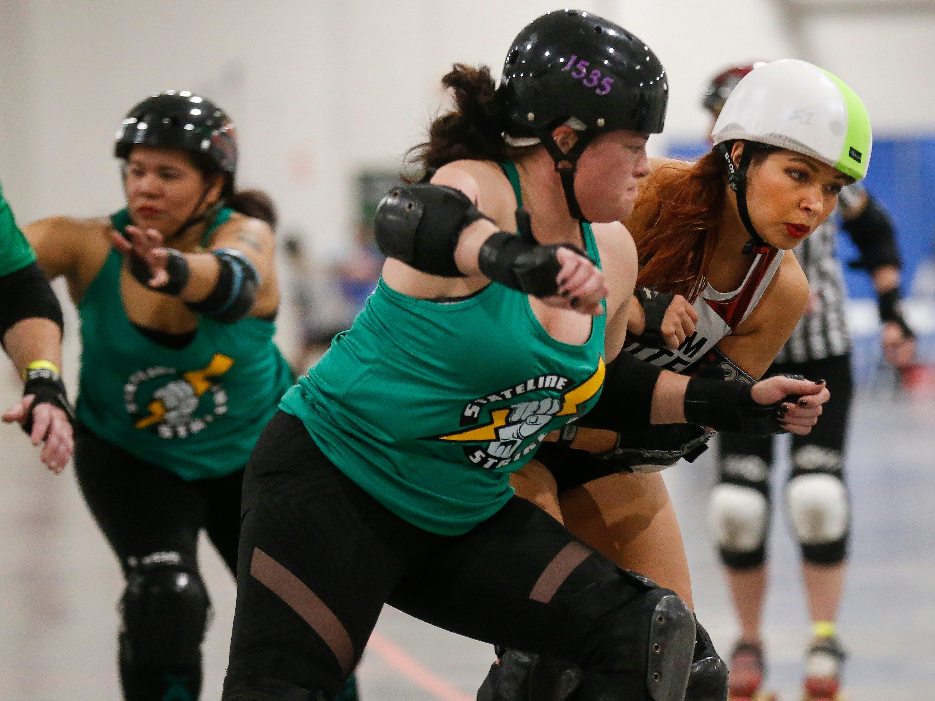 The Shockers (in white tops) defeated the Strikers 140-43 in the first game of the 2019 Roller Derby M.A.D.E. Nationals at the Ozark Empire Fairgrounds on Saturday, Feb. 2, 2019.