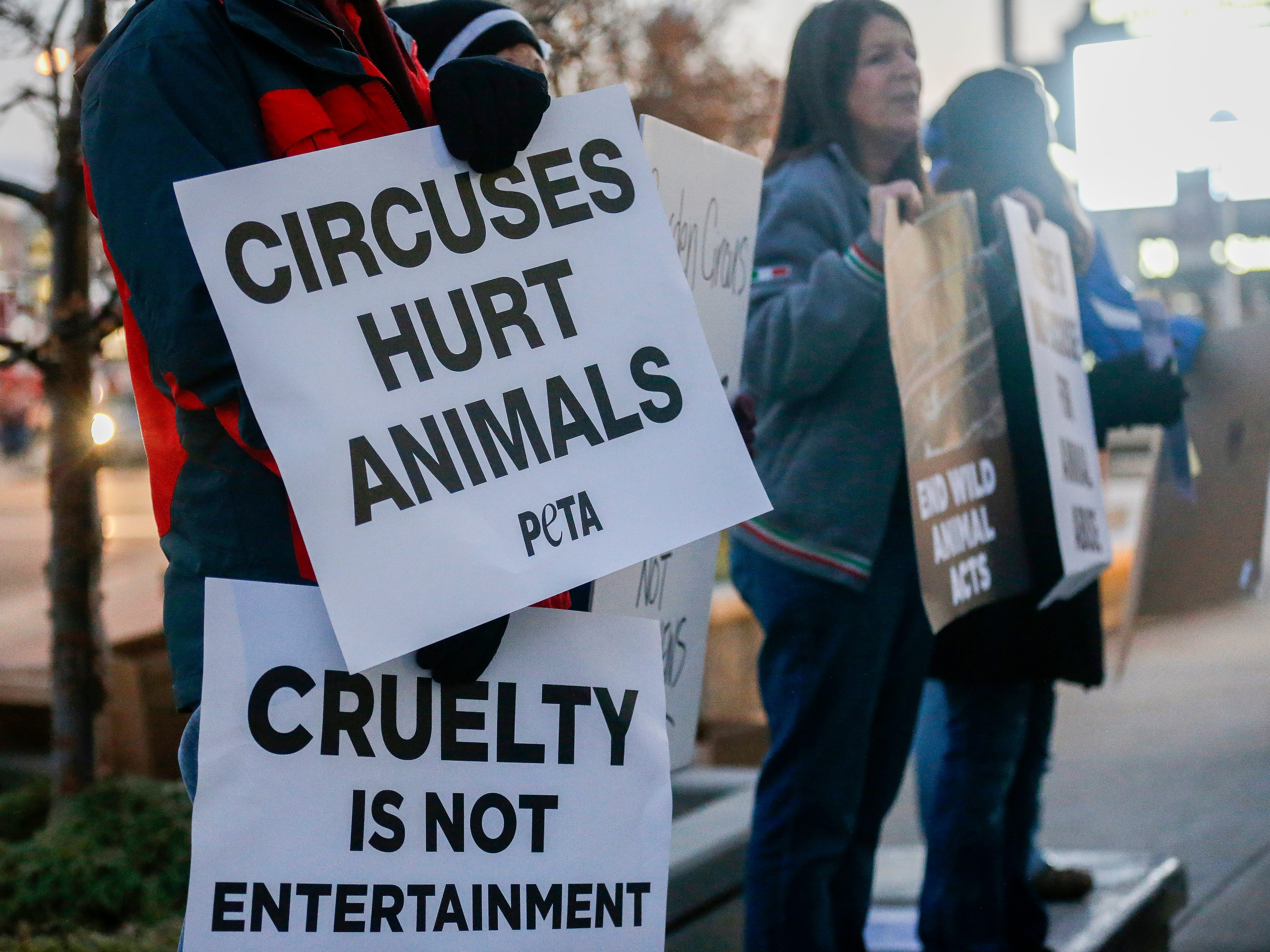 Animal rights activists protest in front of JQH Arena against the use of animals in the Carden Circus on Friday, Feb. 1, 2019.