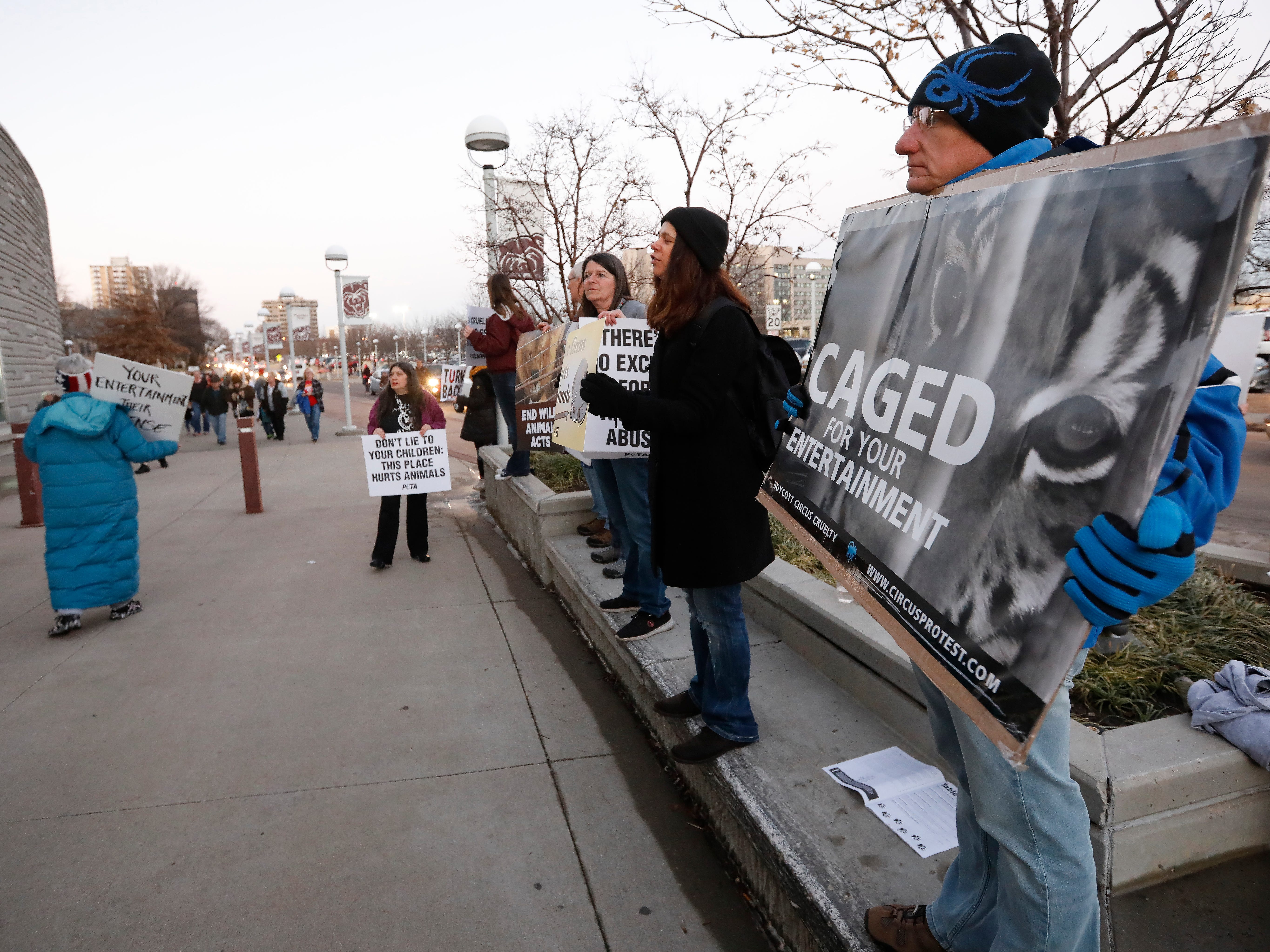 Animal rights activist Hans Gilgen, right, protests in front of JQH Arena against the use of animals in the Carden Circus on Friday, Feb. 1, 2019.