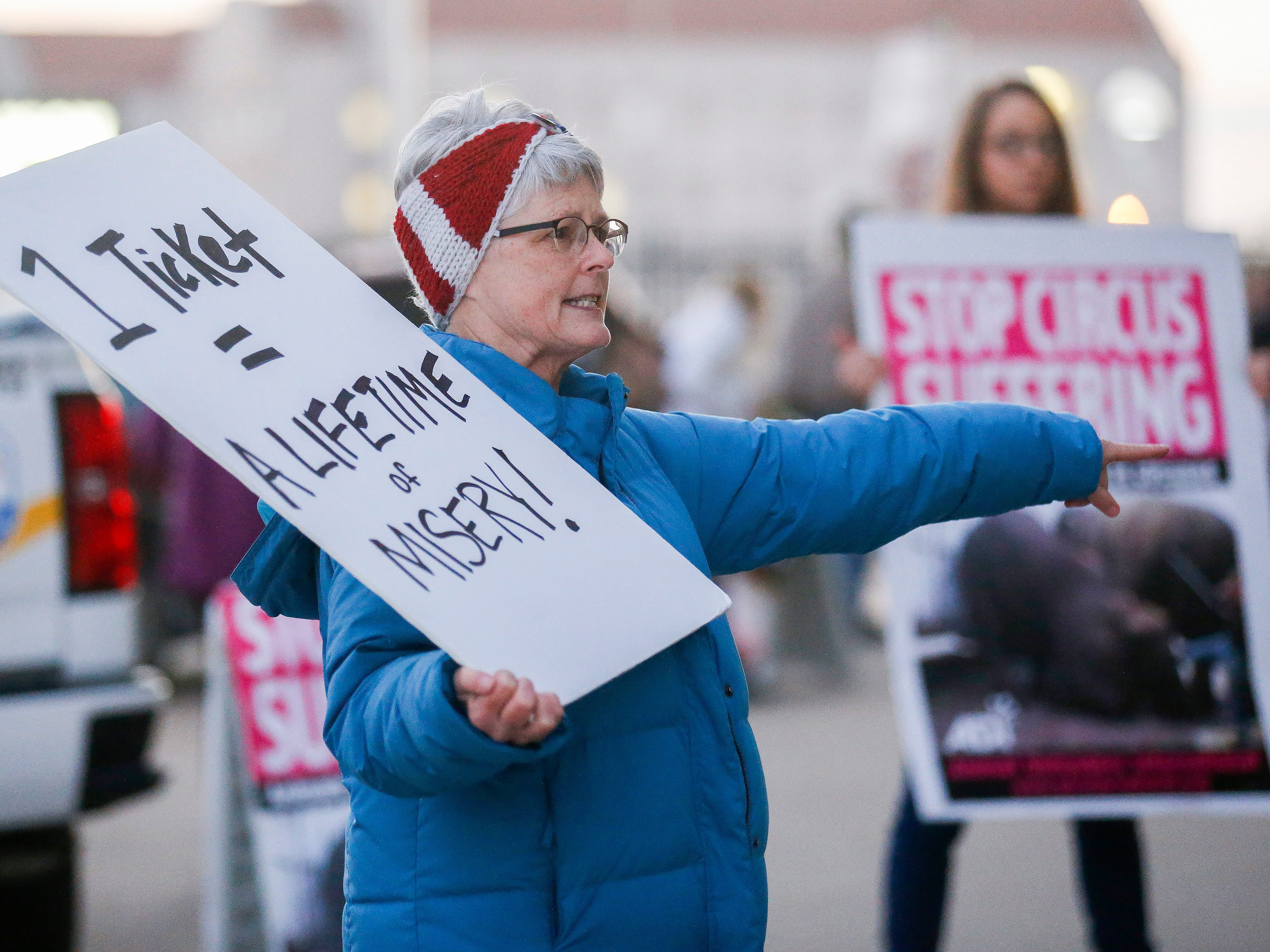 Animal rights activist Laura Umphenour protests in front of JQH Arena against the use of animals in the Carden Circus on Friday, Feb. 1, 2019.
