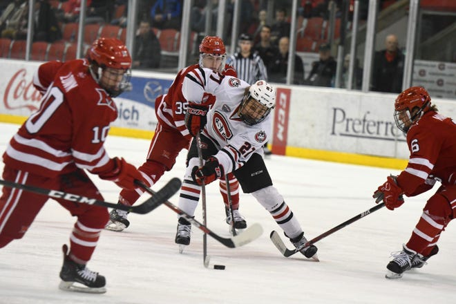 St. Cloud State sophomore Blake Lizotte (#27) dangles around the Miami defense in Friday's NCHC contest at the Herb Brooks National Hockey Center.