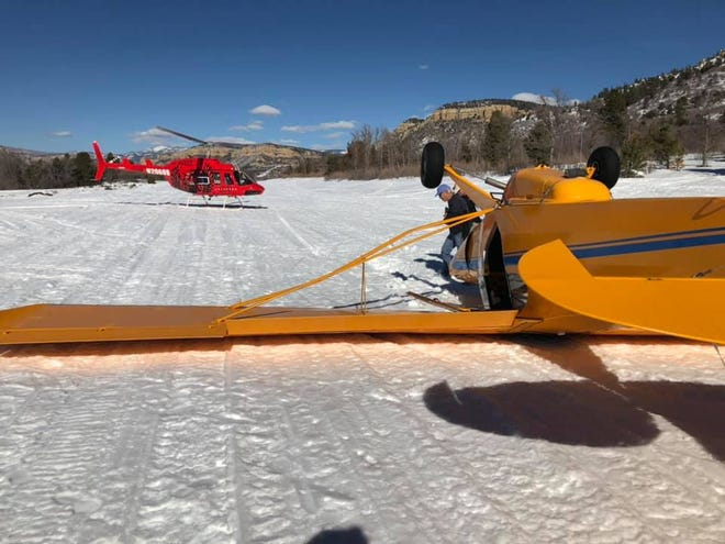 A plane landed upside down on a private runway north of Zion National Park on Friday. The pilot and one passenger suffered minor injuries in the crash, according to the Iron County Sheriff's Office.