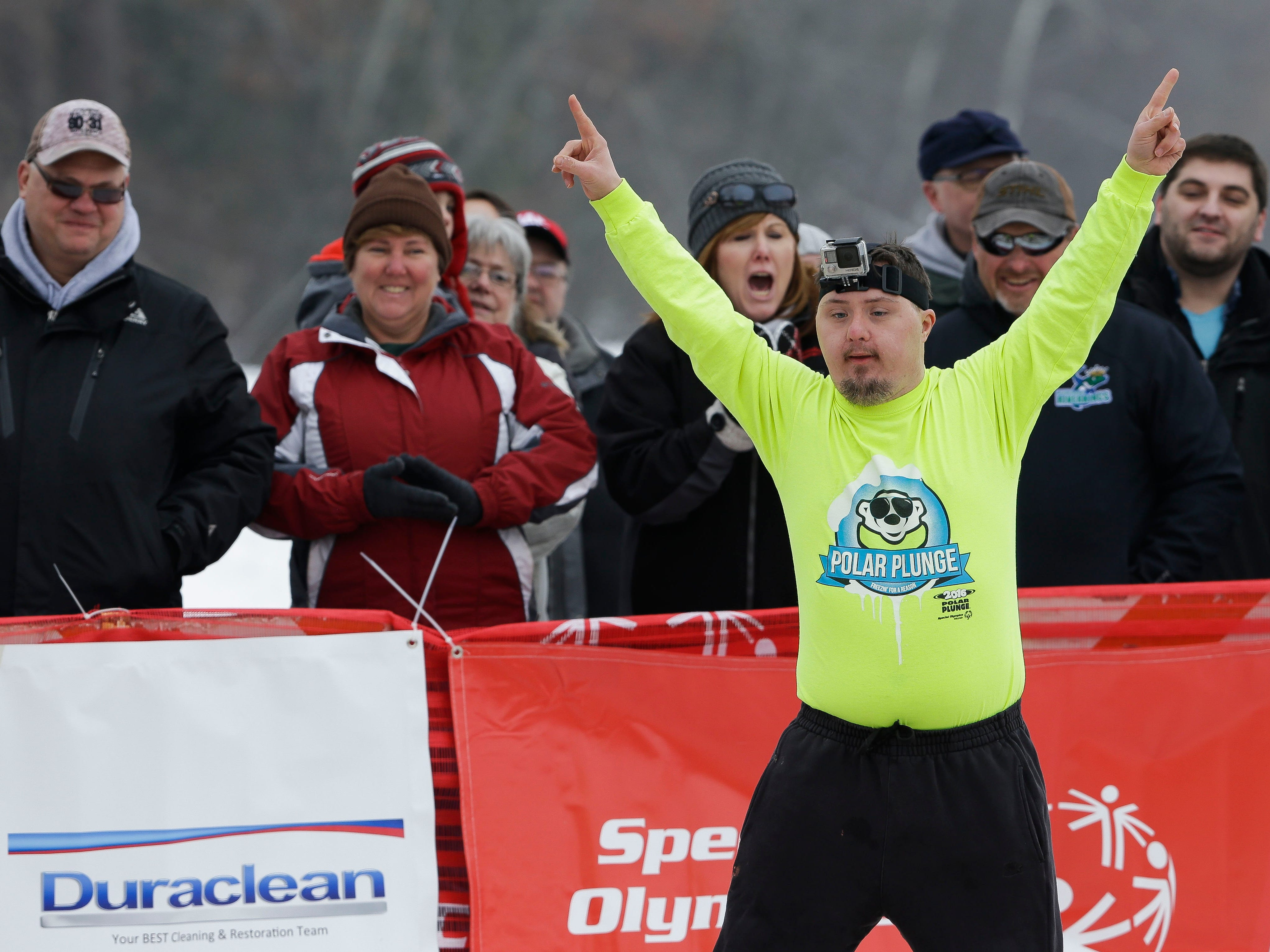 A participant pumps up the crowd before taking a polar plunge on Saturday, February 2, 2019, at Anchor Bay Bar and Grill in Biron, Wis. The event was one of many polar plunges across the state held as fundraisers for Special Olympics Wisconsin.Tork Mason/USA TODAY NETWORK-Wisconsin