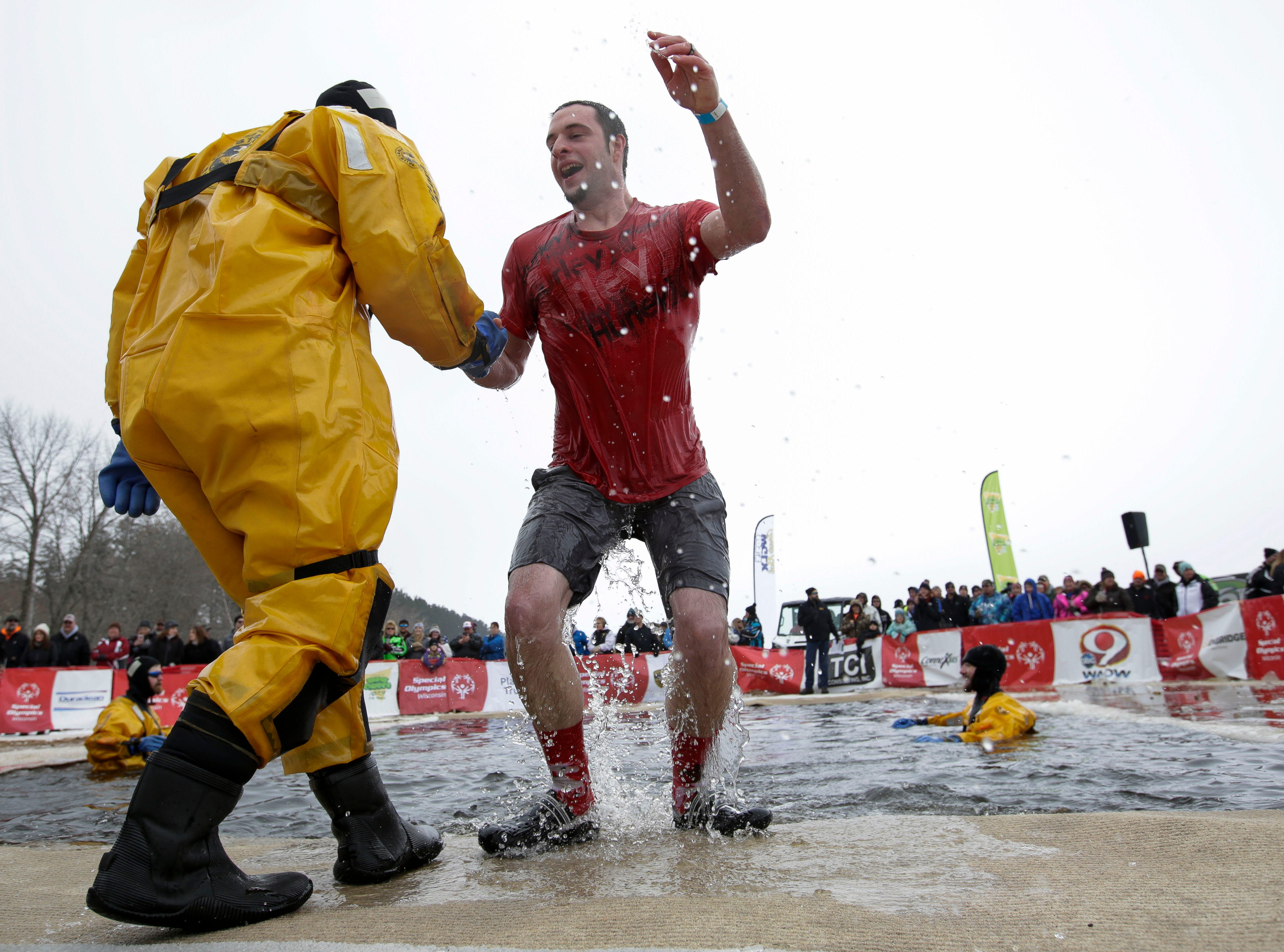 A participant exits the water after taking the polar plunge on Saturday, February 2, 2019, at Anchor Bay Bar and Grill in Biron, Wis. The event was one of many polar plunges across the state held as fundraisers for Special Olympics Wisconsin.Tork Mason/USA TODAY NETWORK-Wisconsin