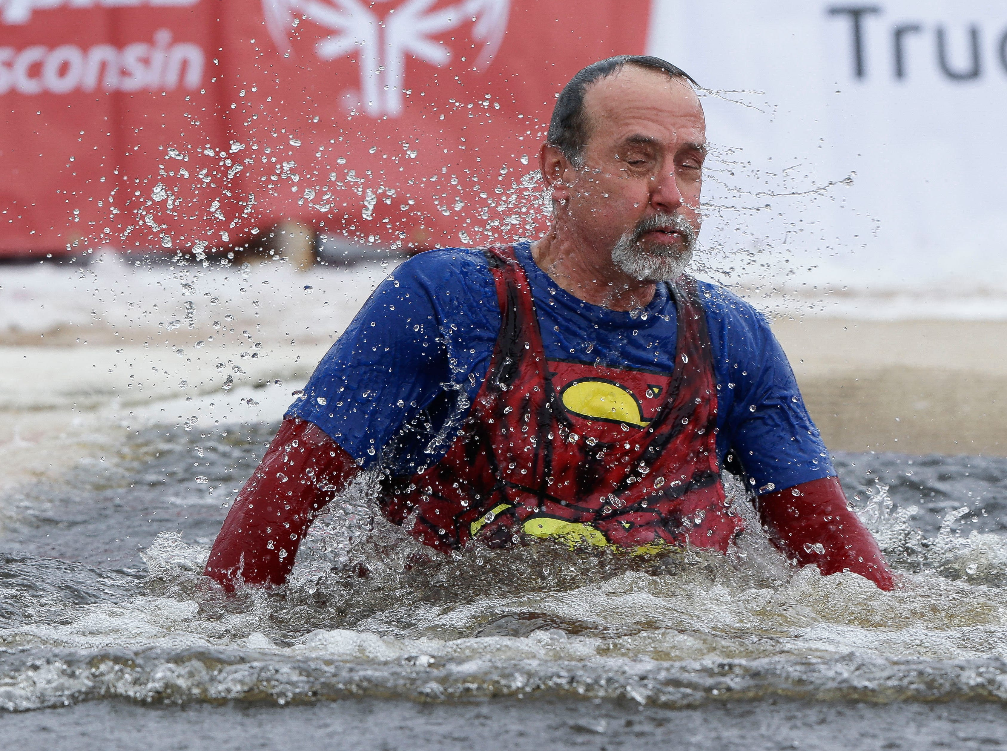 A participant emerges from the water after taking a polar plunge on Saturday, February 2, 2019, at Anchor Bay Bar and Grill in Biron, Wis. The event was one of many polar plunges across the state held as fundraisers for Special Olympics Wisconsin.Tork Mason/USA TODAY NETWORK-Wisconsin