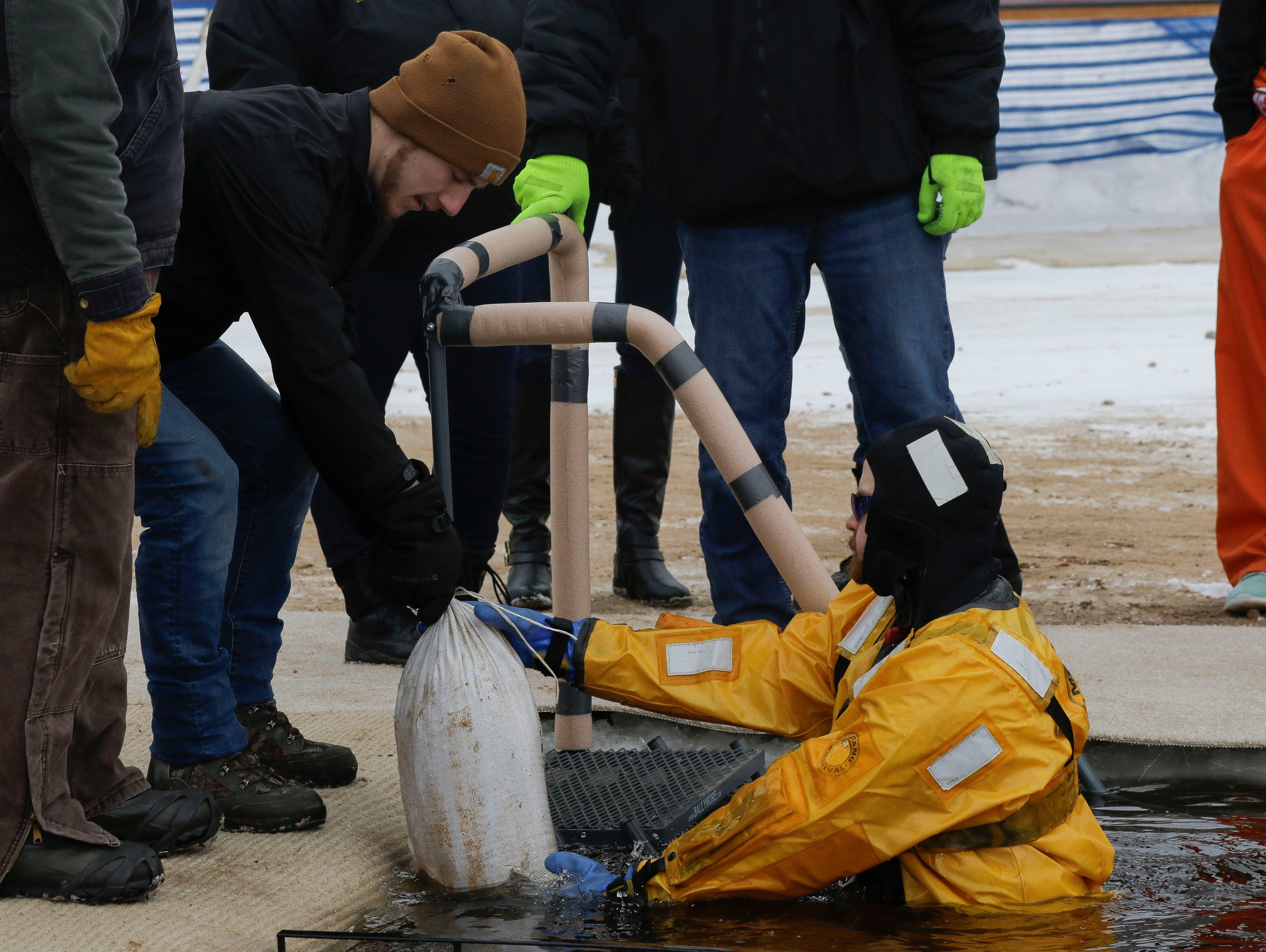 Members of the Wood County Sheriff's Rescue team secure a step ladder in the pool prior to a polar plunge event on Saturday, February 2, 2019, at Anchor Bay Bar and Grill in Biron, Wis. The event was one of many polar plunges across the state held as fundraisers for Special Olympics Wisconsin.Tork Mason/USA TODAY NETWORK-Wisconsin