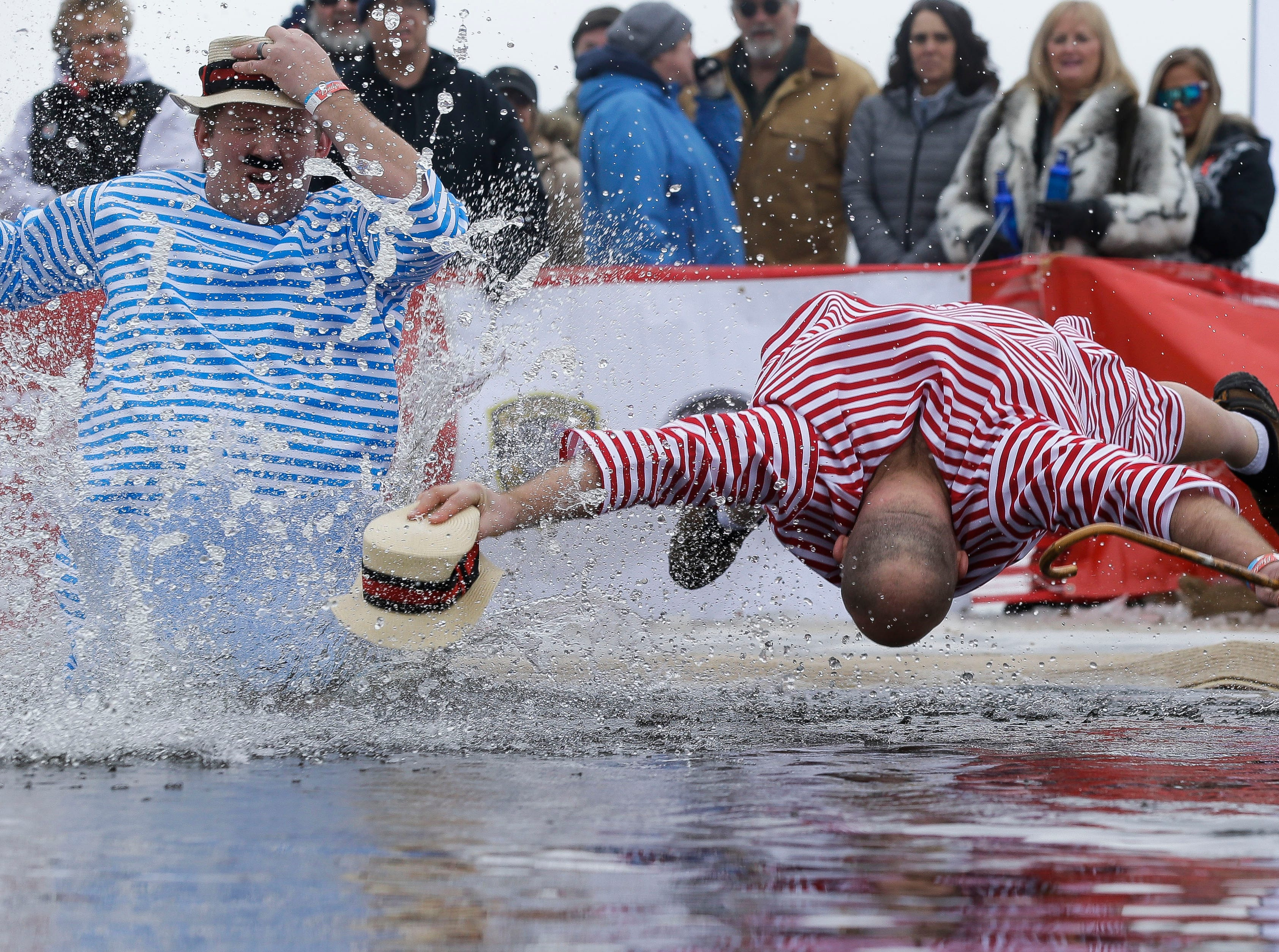 Participants take the polar plunge on Saturday, February 2, 2019, at Anchor Bay Bar and Grill in Biron, Wis. The event was one of many polar plunges held across the state as fundraisers for Special Olympics Wisconsin.Tork Mason/USA TODAY NETWORK-Wisconsin