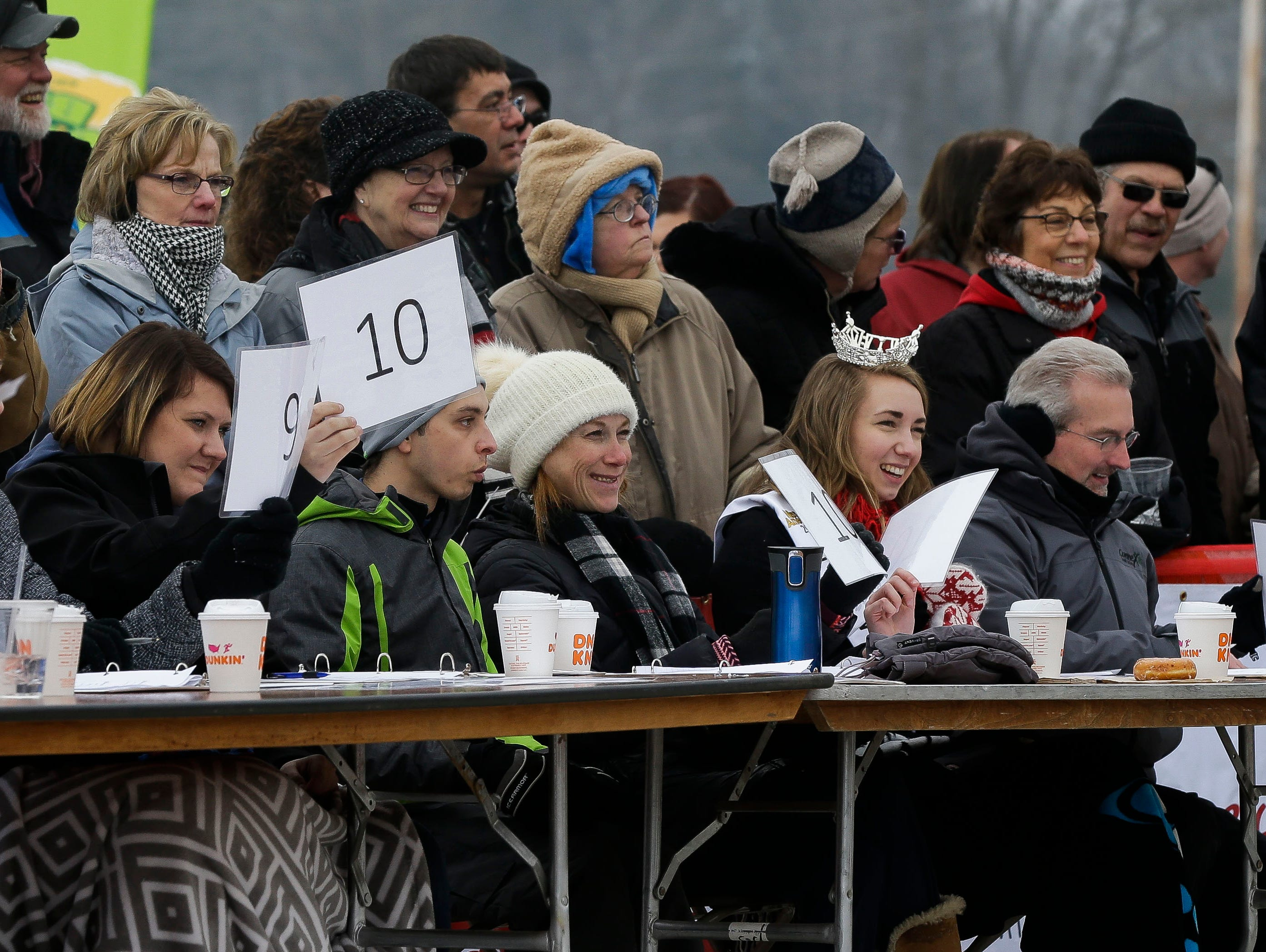Polar plunge judges present their scores on Saturday, February 2, 2019, at Anchor Bay Bar and Grill in Biron, Wis. The event was one of many polar plunges across the state held as fundraisers for Special Olympics Wisconsin.Tork Mason/USA TODAY NETWORK-Wisconsin