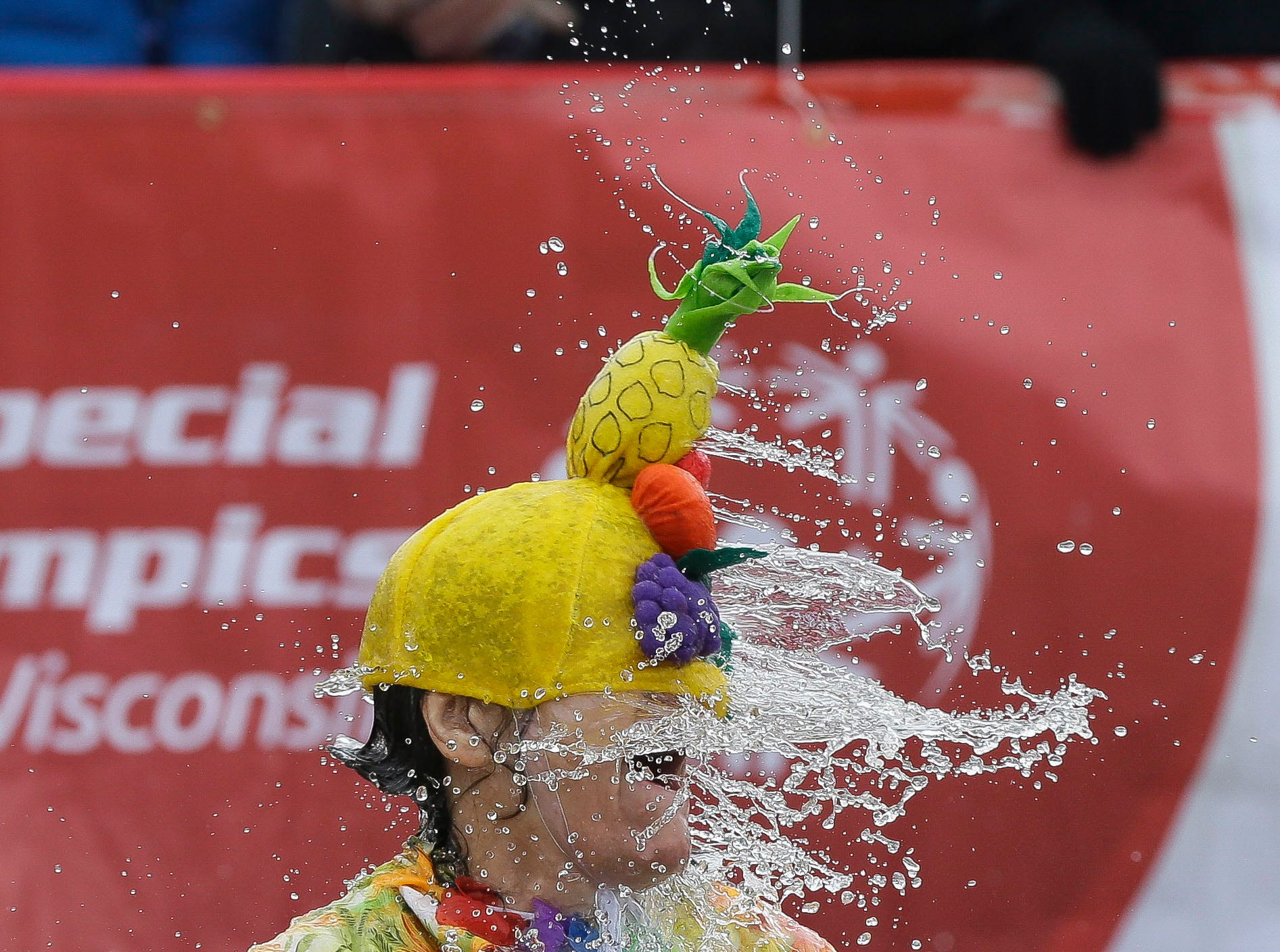 A participant emerges from the water after taking the polar plunge on Saturday, February 2, 2019, at Anchor Bay Bar and Grill in Biron, Wis. The event was one of many polar plunges across the state held as fundraisers for Special Olympics Wisconsin.Tork Mason/USA TODAY NETWORK-Wisconsin