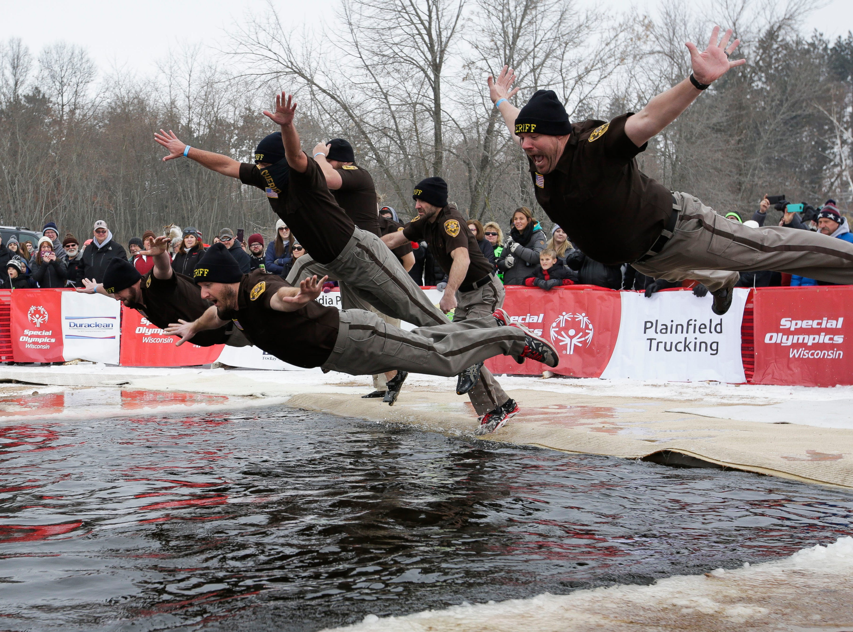 Members of the Wood County Sheriff's Department take the polar plunge on Saturday, February 2, 2019, at Anchor Bay Bar and Grill in Biron, Wis. The event was one of many polar plunges across the state held as fundraisers for Special Olympics Wisconsin.Tork Mason/USA TODAY NETWORK-Wisconsin