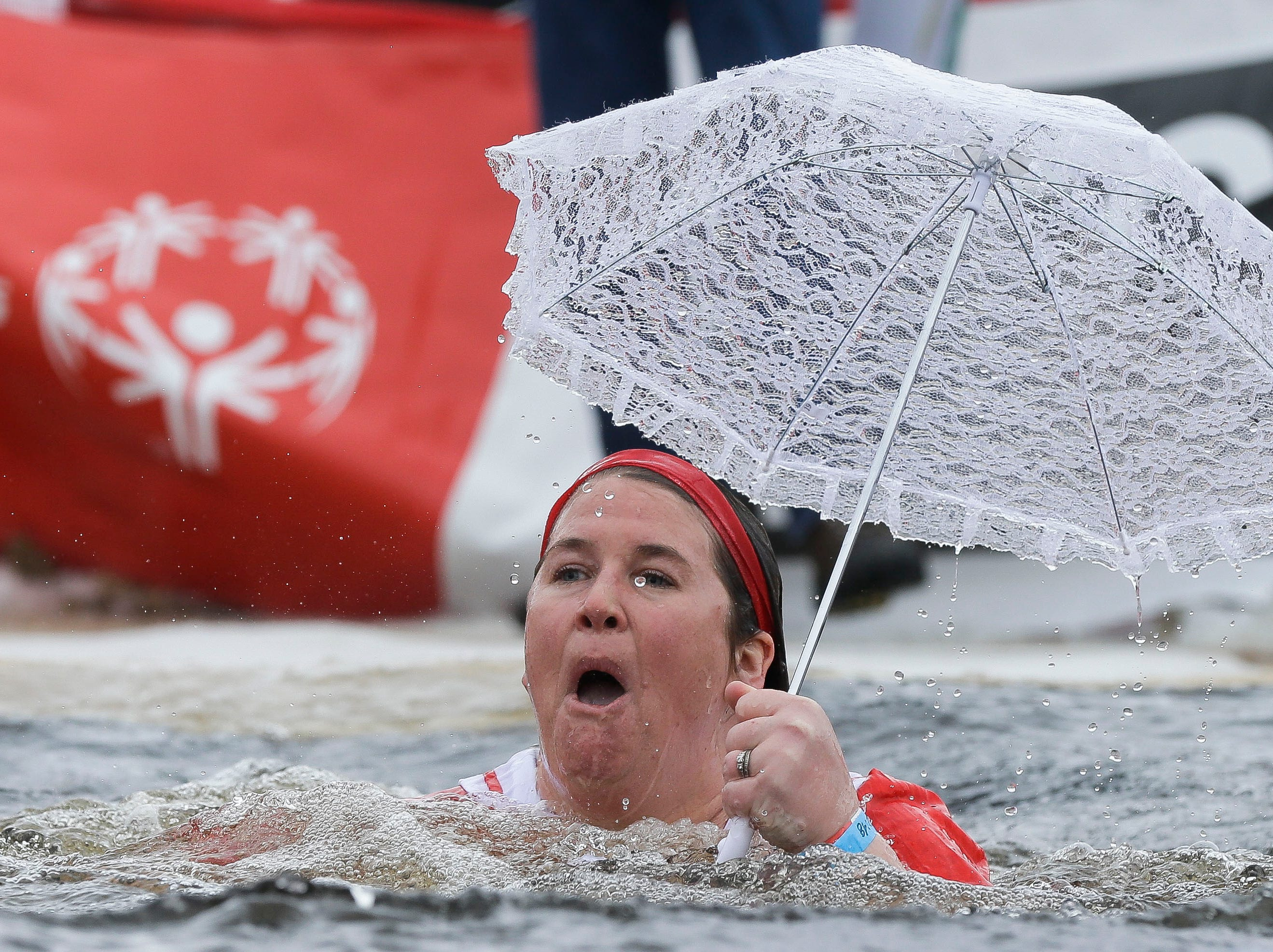 A participant heads to water's edge after taking the polar plunge on Saturday, February 2, 2019, at Anchor Bay Bar and Grill in Biron, Wis. The event was one of many polar plunges across the state held as fundraisers for Special Olympics Wisconsin.Tork Mason/USA TODAY NETWORK-Wisconsin