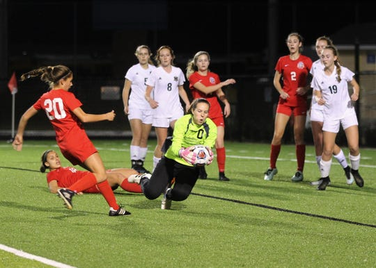 Lincoln keeper Pamela Moore beats Leon's Eden Kirn to a corner kick, securing the ball was loose on the ground as Leon's girls soccer team beat Lincoln 2-1 in the District 2-4A championship at Gene Cox Stadium on Feb. 1, 2019.