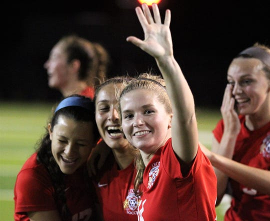 """Leon senior Emma McGibany signals """"five peat"""" as Leon's girls soccer team beat Lincoln 2-1 in the District 2-4A championship at Gene Cox Stadium on Feb. 1, 2019."""