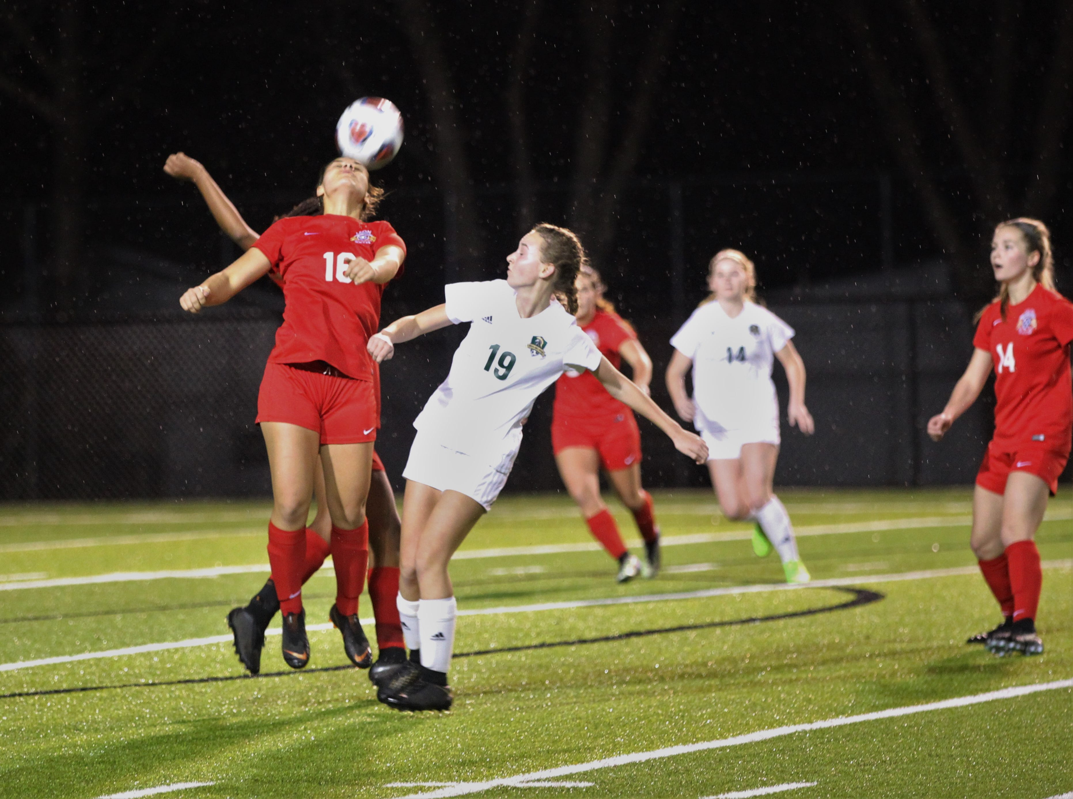 Leon's Eden Kirn heads a ball before Lincoln's Lexi Gray can get there as Leon's girls soccer team beat Lincoln in the District 2-4A championship on Feb. 1, 2019.