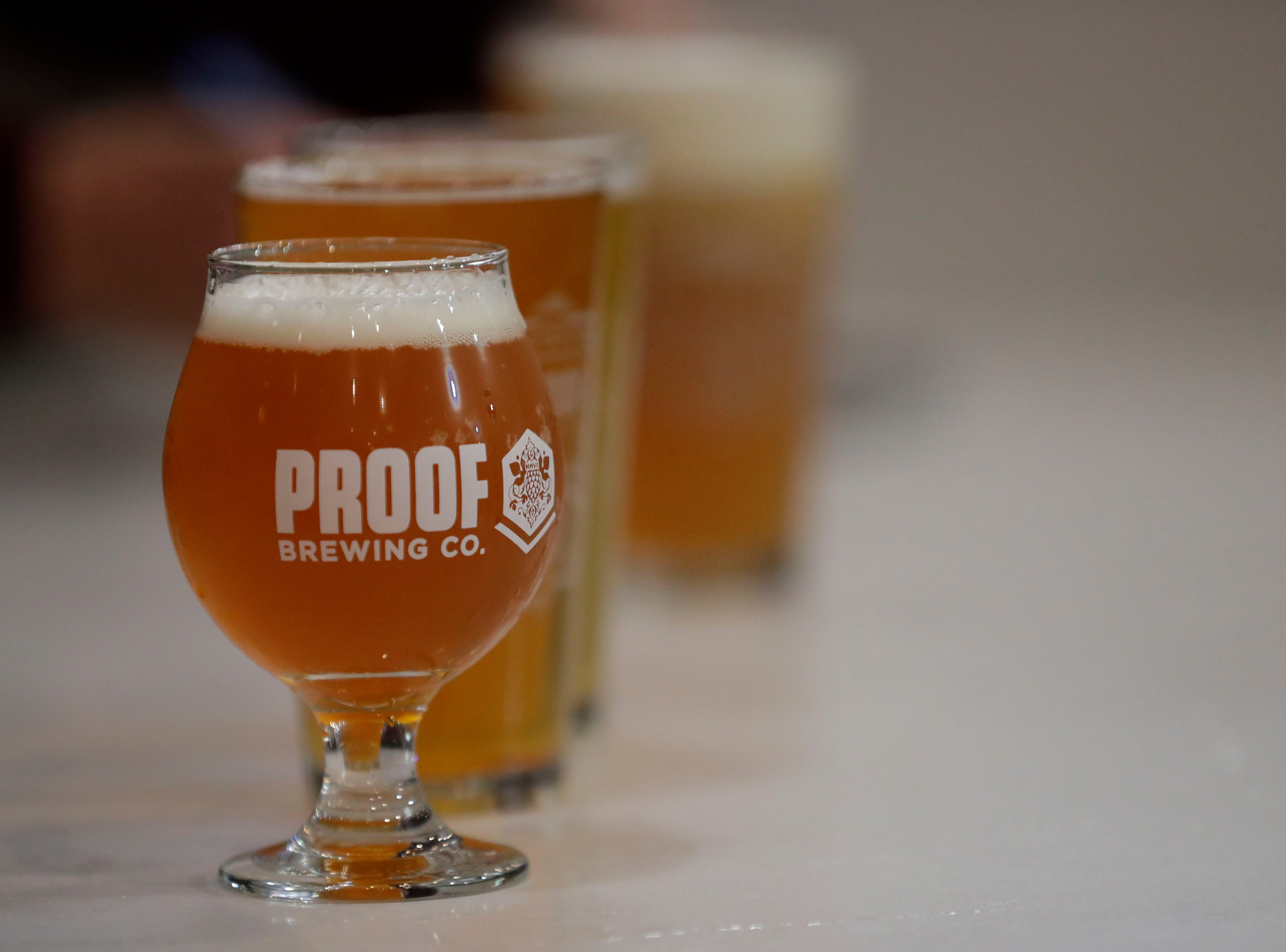 Freshly poured beers sit on the bar the new Proof Brewery during their soft opening, Friday, Feb. 1, 2019.