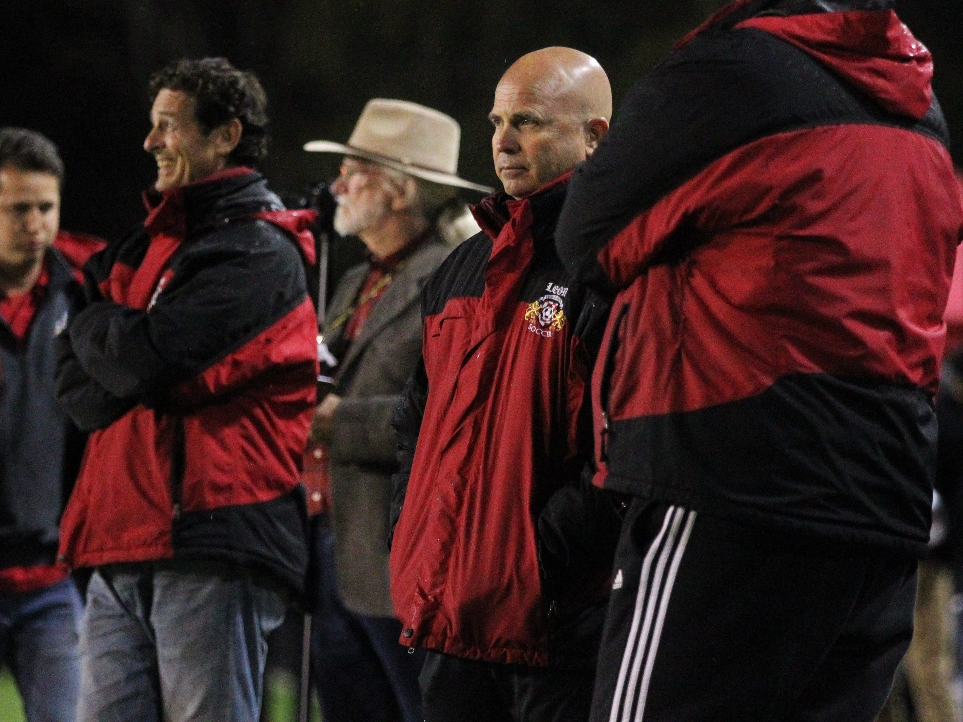 Leon girls soccer coach Tony Kidd watches from the sidelines during the Lions' 2-1 win over Lincoln on Friday to capture a fifth-straight district title.