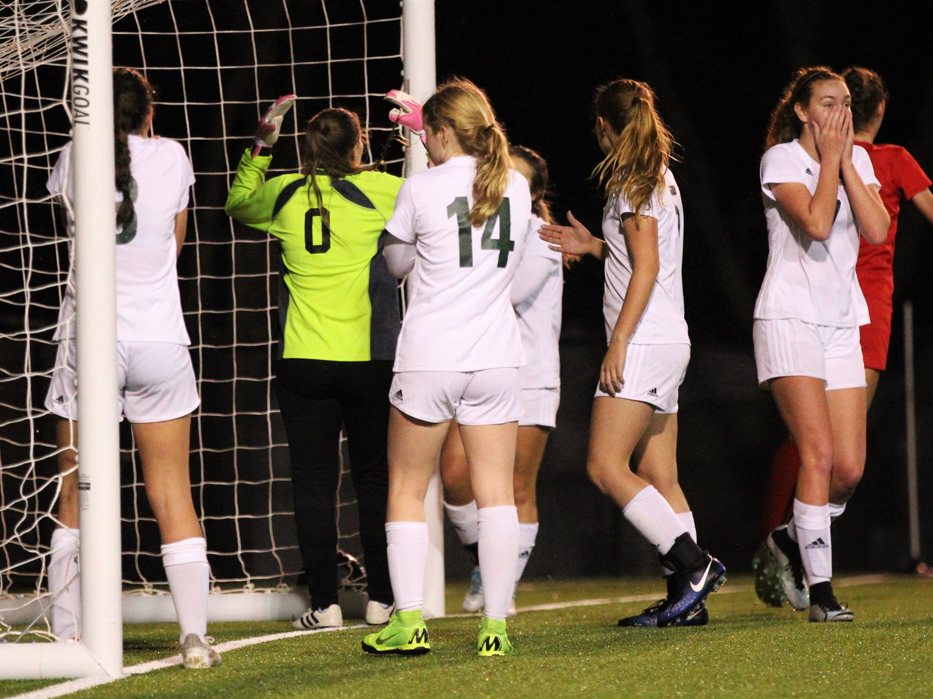 Lincoln keeper Pamela Moore and the Trojans react to Leon senior Liney Brantley sneaking a game-tying goal inside the near post on a corner kick as Leon's girls soccer team beat Lincoln 2-1 in the District 2-4A championship at Gene Cox Stadium on Feb. 1, 2019.