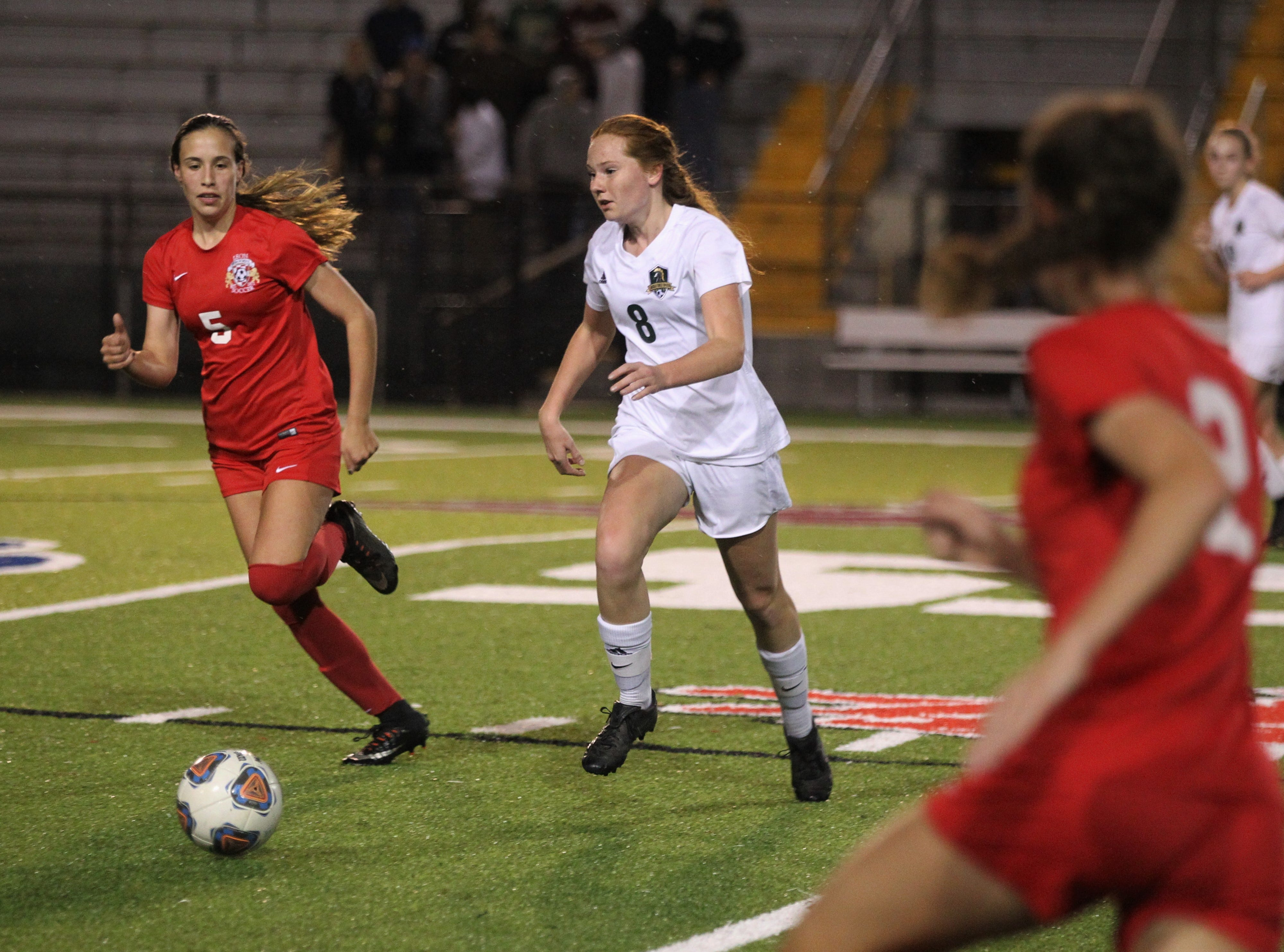Lincoln's Rylee French dribbles through the midfield as Leon's girls soccer team beat Lincoln in the District 2-4A championship on Feb. 1, 2019.