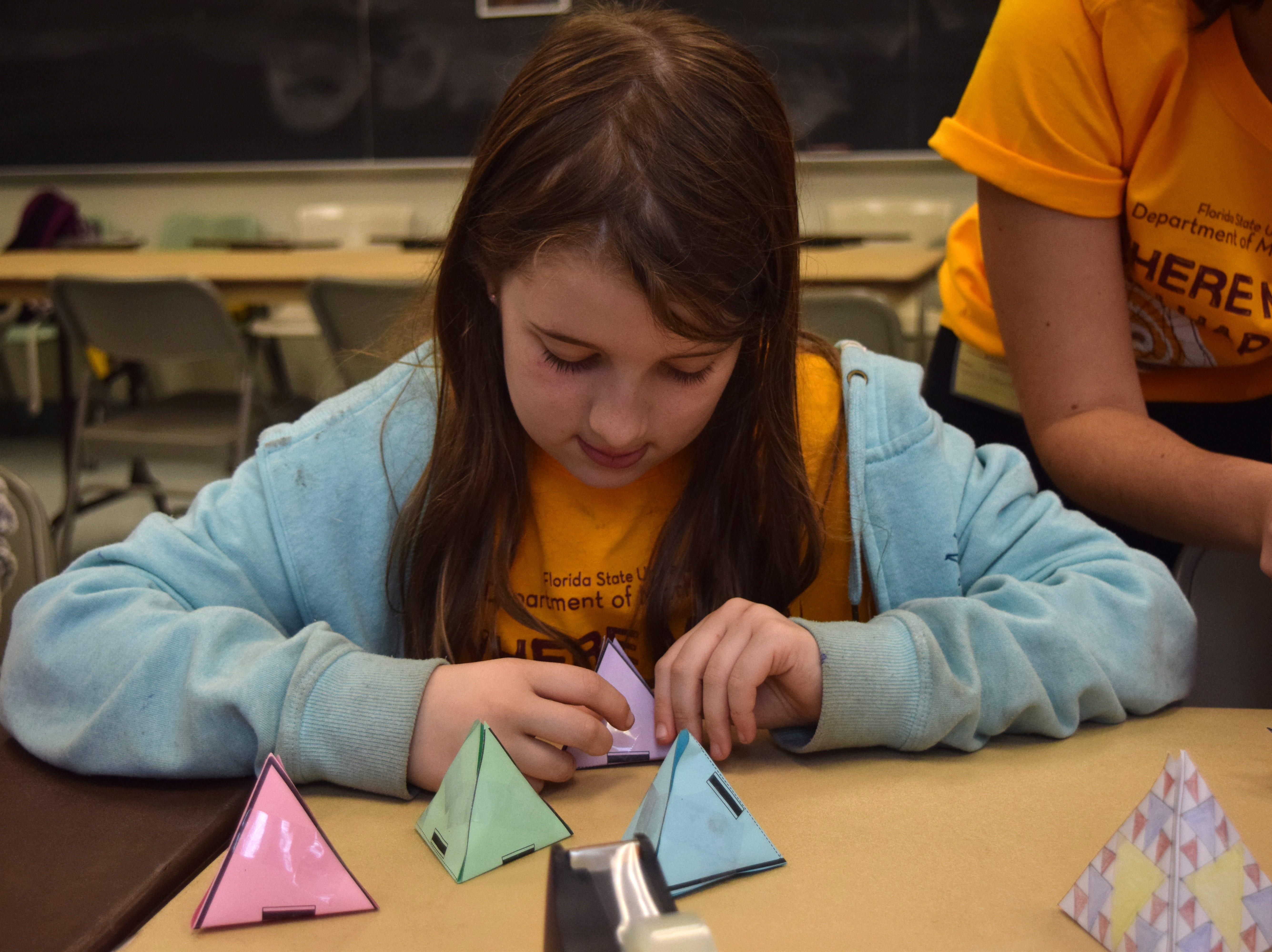 Angela Watts builds a fractal during Fun Math Day at Florida State. The 10-year-old likes math because it's fun.