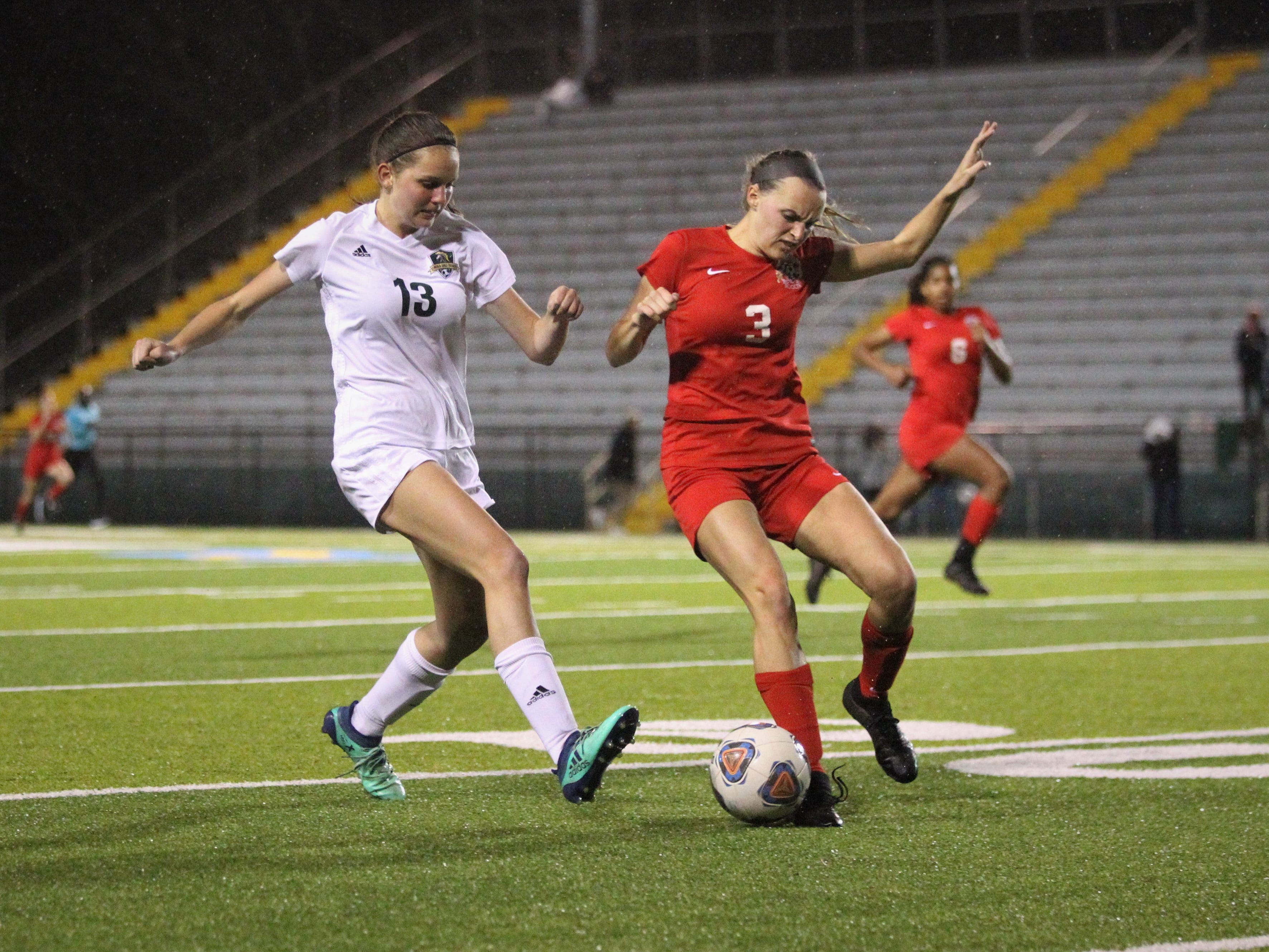 Leon senior defender Madison Rumenik gets to a through ball before Lincoln's Olivia Rehwinkel can as Leon's girls soccer team beat Lincoln 2-1 in the District 2-4A championship at Gene Cox Stadium on Feb. 1, 2019.