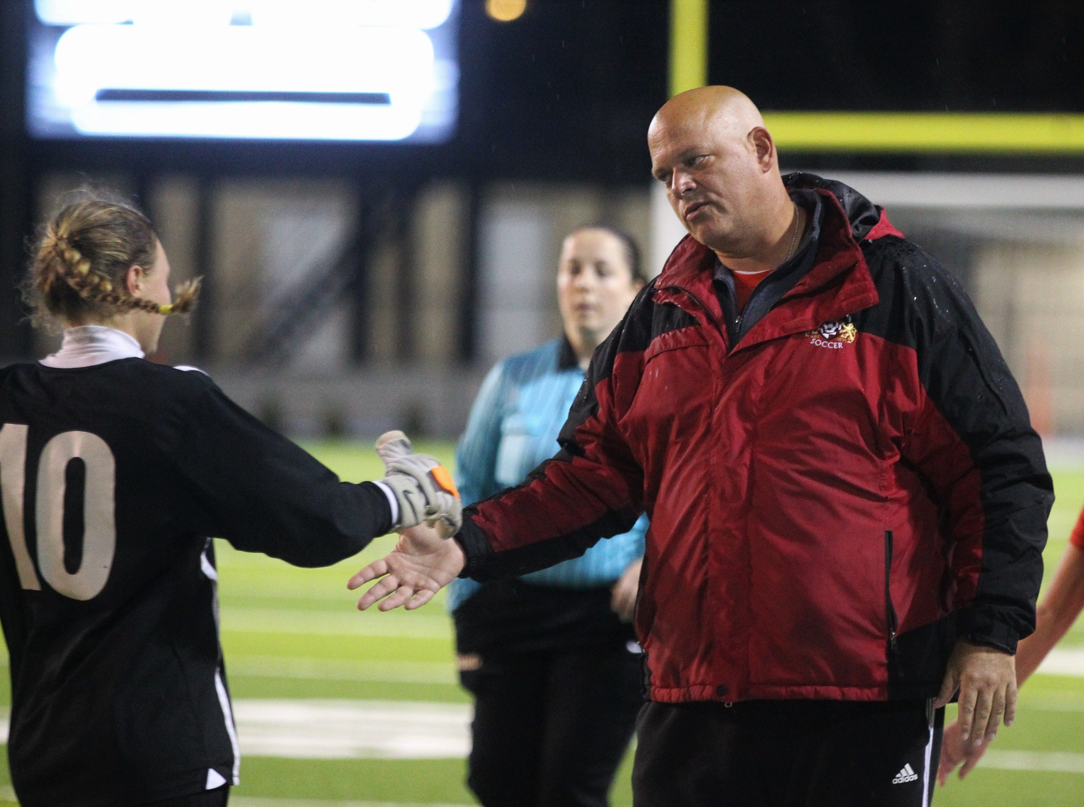 Leon goalies coach Lance Kirwin comes out to meet upset keeper Regan Hermeling at the first-half water break after an unfortunate goal, but Leon's girls soccer team rallied to beat Lincoln 2-1 in the District 2-4A championship on Feb. 1, 2019.