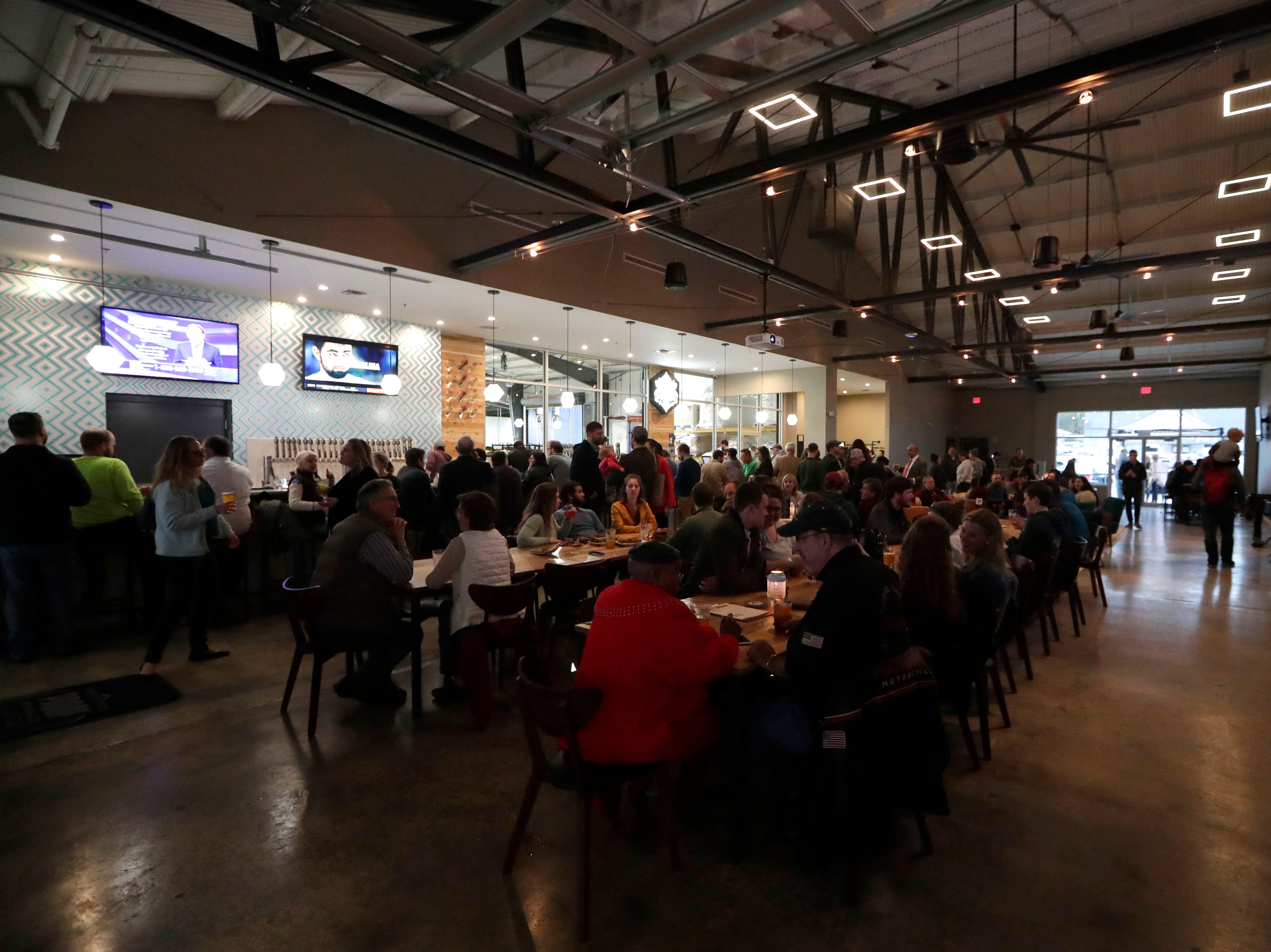 The inside seating and bar area packed with people at the new Proof Brewery during their soft opening Friday, Feb. 1, 2019.