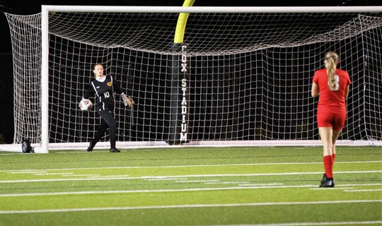 Leon keeper Regan Hermeling rolls rthe ball back to midfield after an unfortunate goal, but Leon's girls soccer team rallied to beat Lincoln 2-1 in the District 2-4A championship on Feb. 1, 2019.