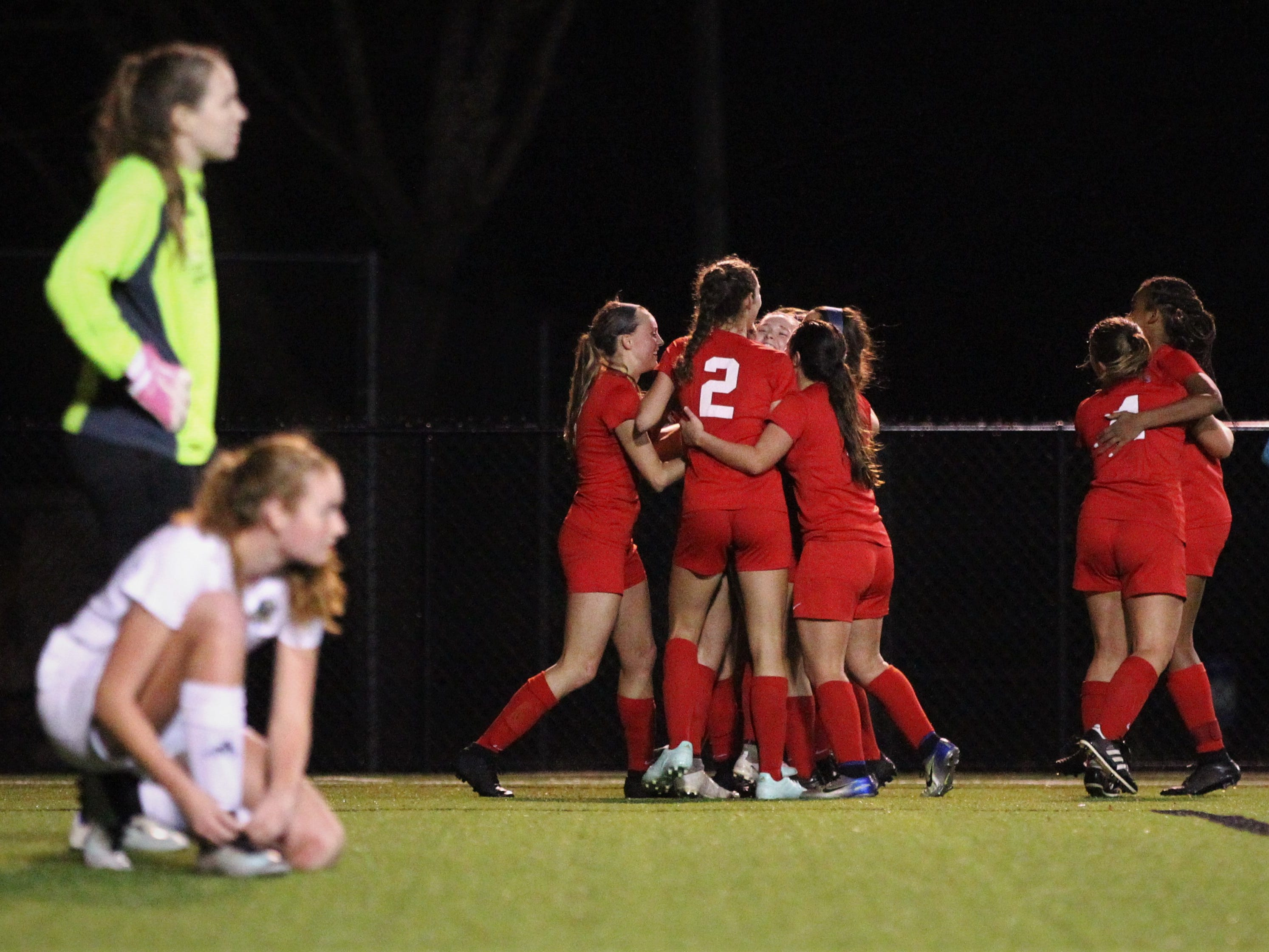 Leon players mob senior Liney Brantley after a game-tying goal that snuck inside the near post on a corner kick as Leon's girls soccer team beat Lincoln 2-1 in the District 2-4A championship at Gene Cox Stadium on Feb. 1, 2019.