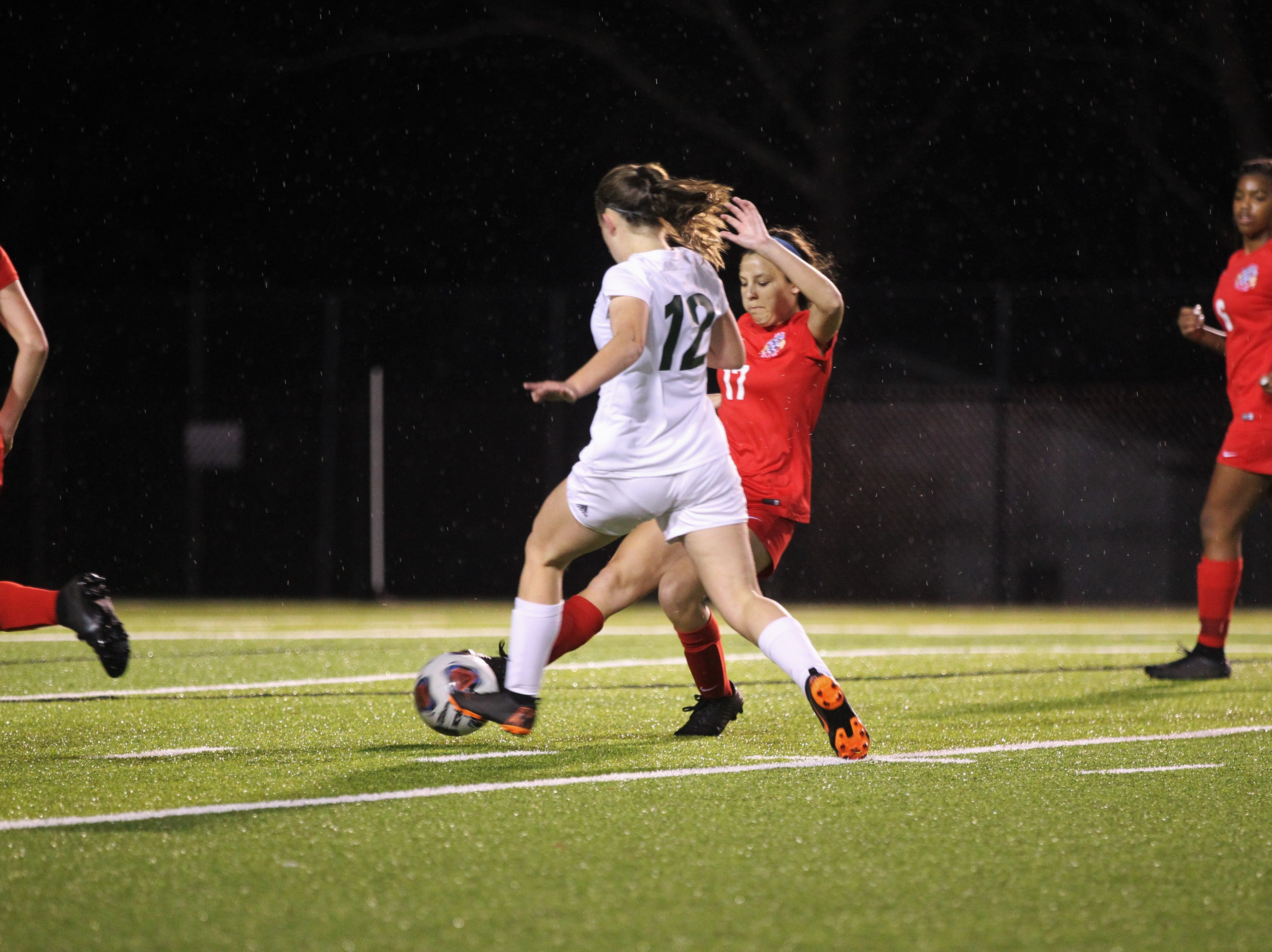 Lincoln's Meredith Camron can't get past Leon defender Leah Mazur as Leon's girls soccer team beat Lincoln in the District 2-4A championship on Feb. 1, 2019.