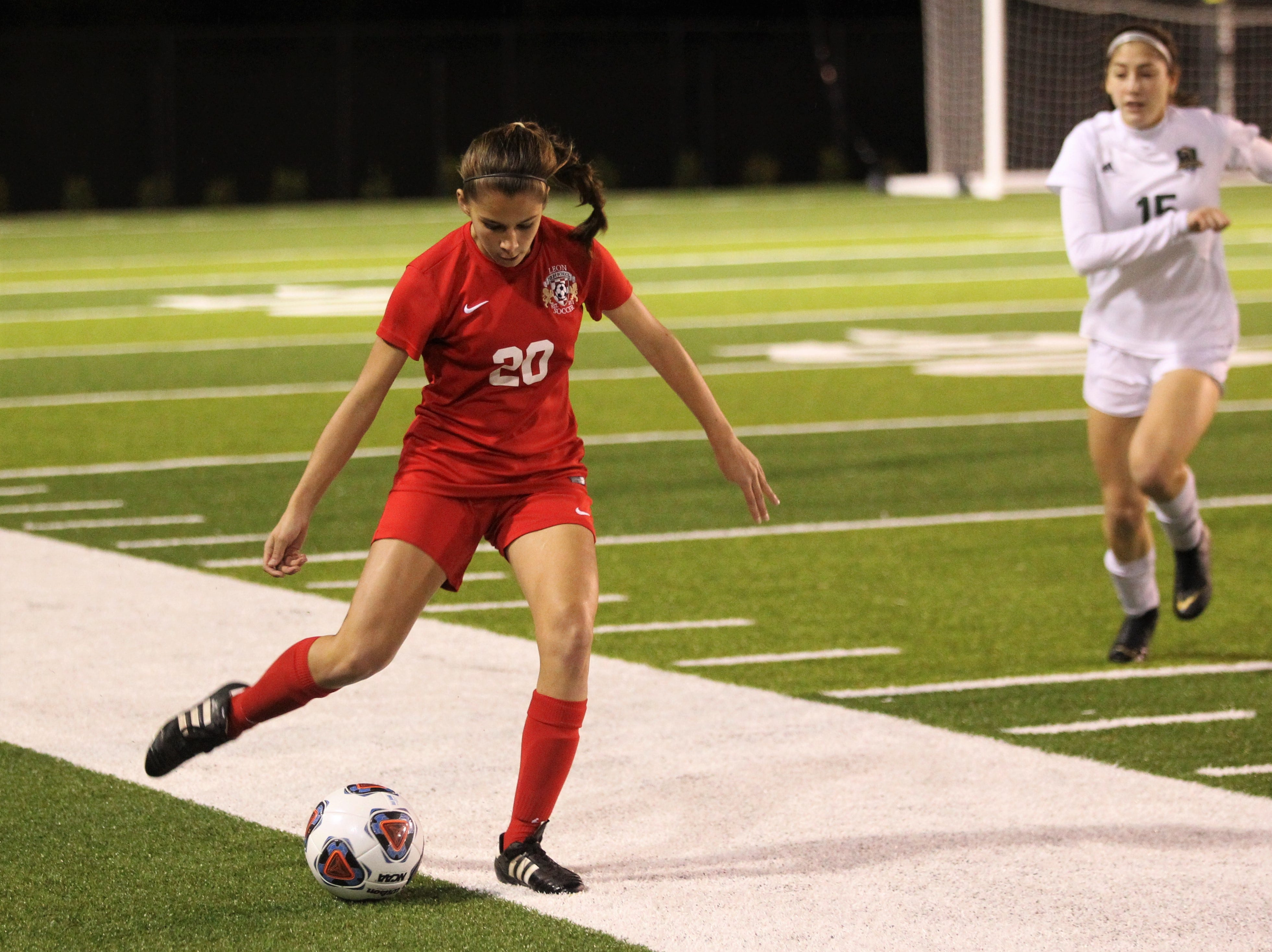 Leon's Camilla Nunez plays a pass as Leon's girls soccer team beat Lincoln in the District 2-4A championship on Feb. 1, 2019.