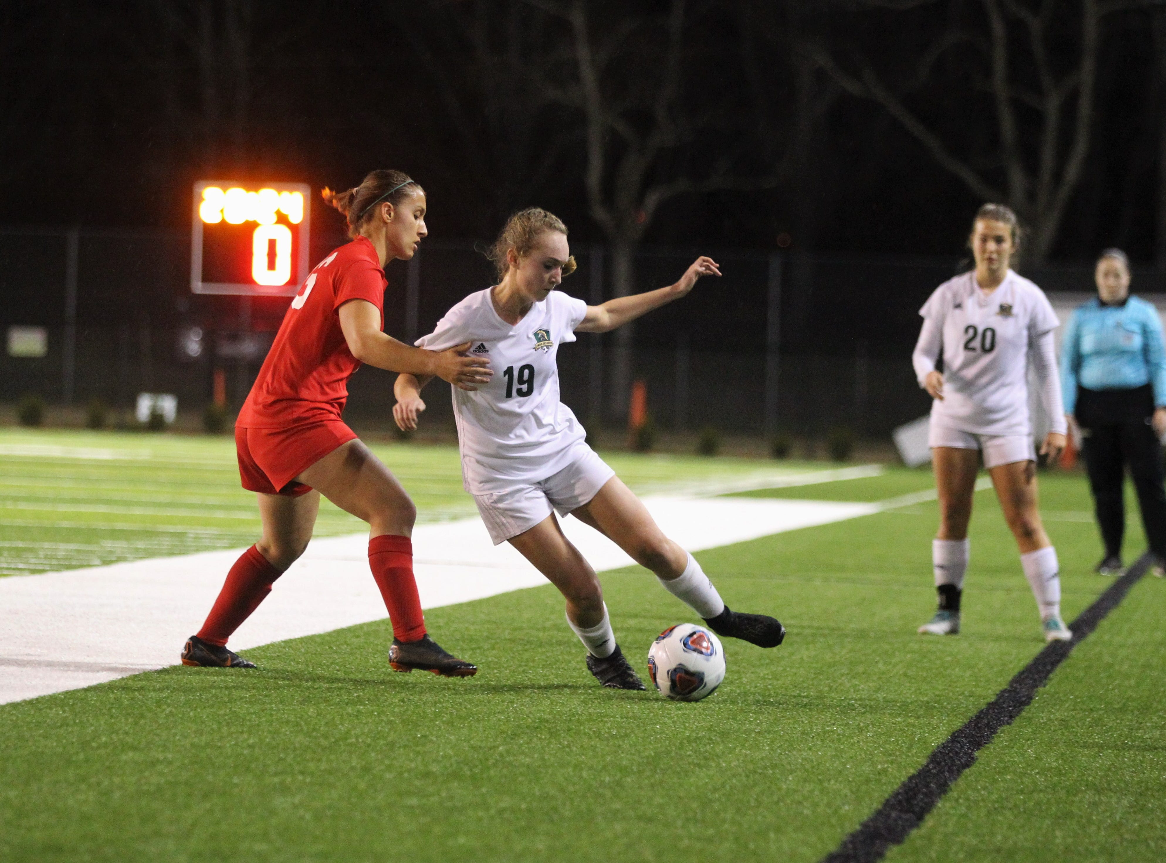 Lincoln midfielder Lexi Gray tries to get pat Leon midfielder Eden Kirn as Leon's girls soccer team beat Lincoln in the District 2-4A championship on Feb. 1, 2019.