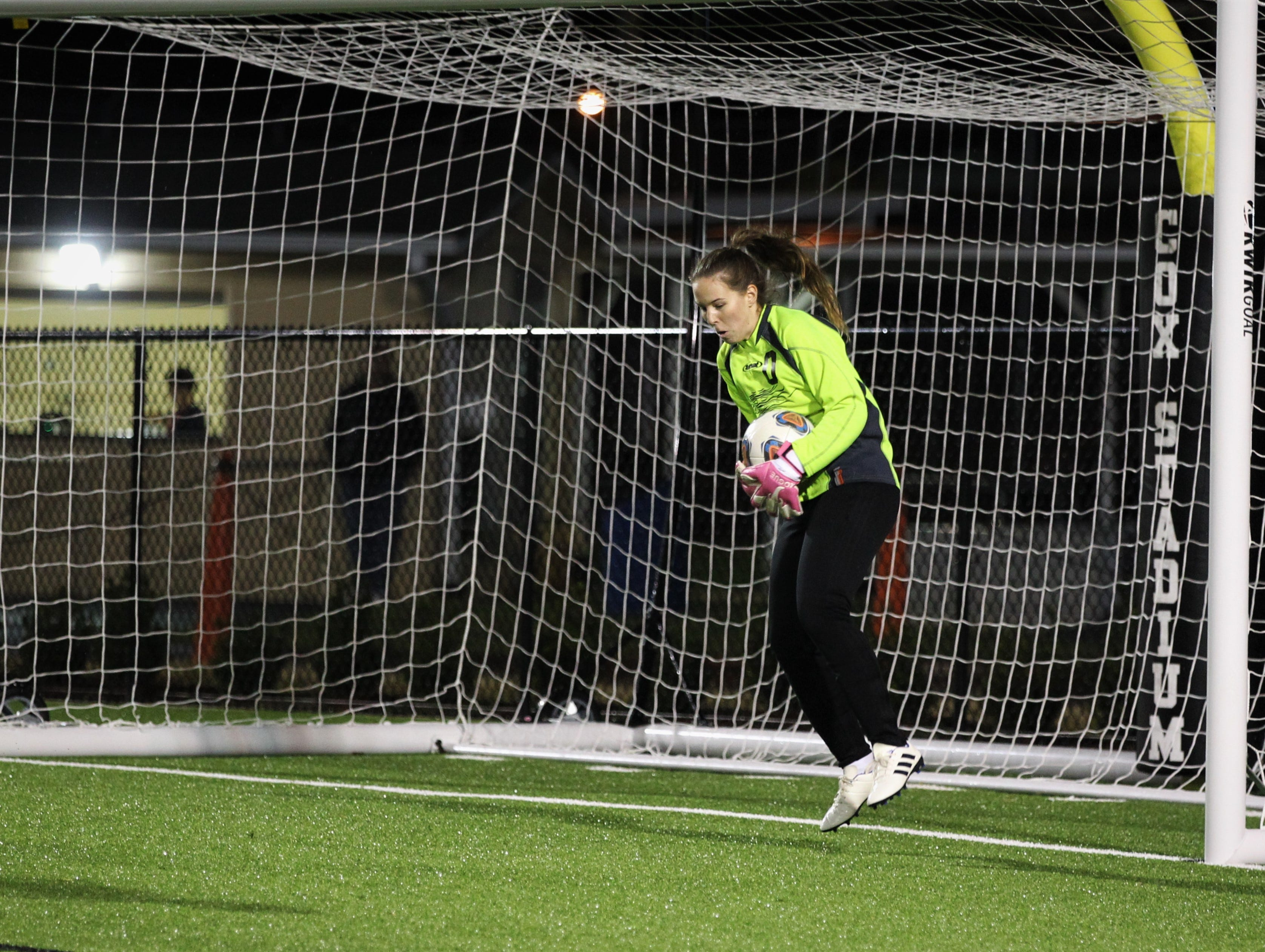 Leon keeper Pamela Moore saves a bouncing shot as Leon's girls soccer team beat Lincoln 2-1 in the District 2-4A championship on Feb. 1, 2019.