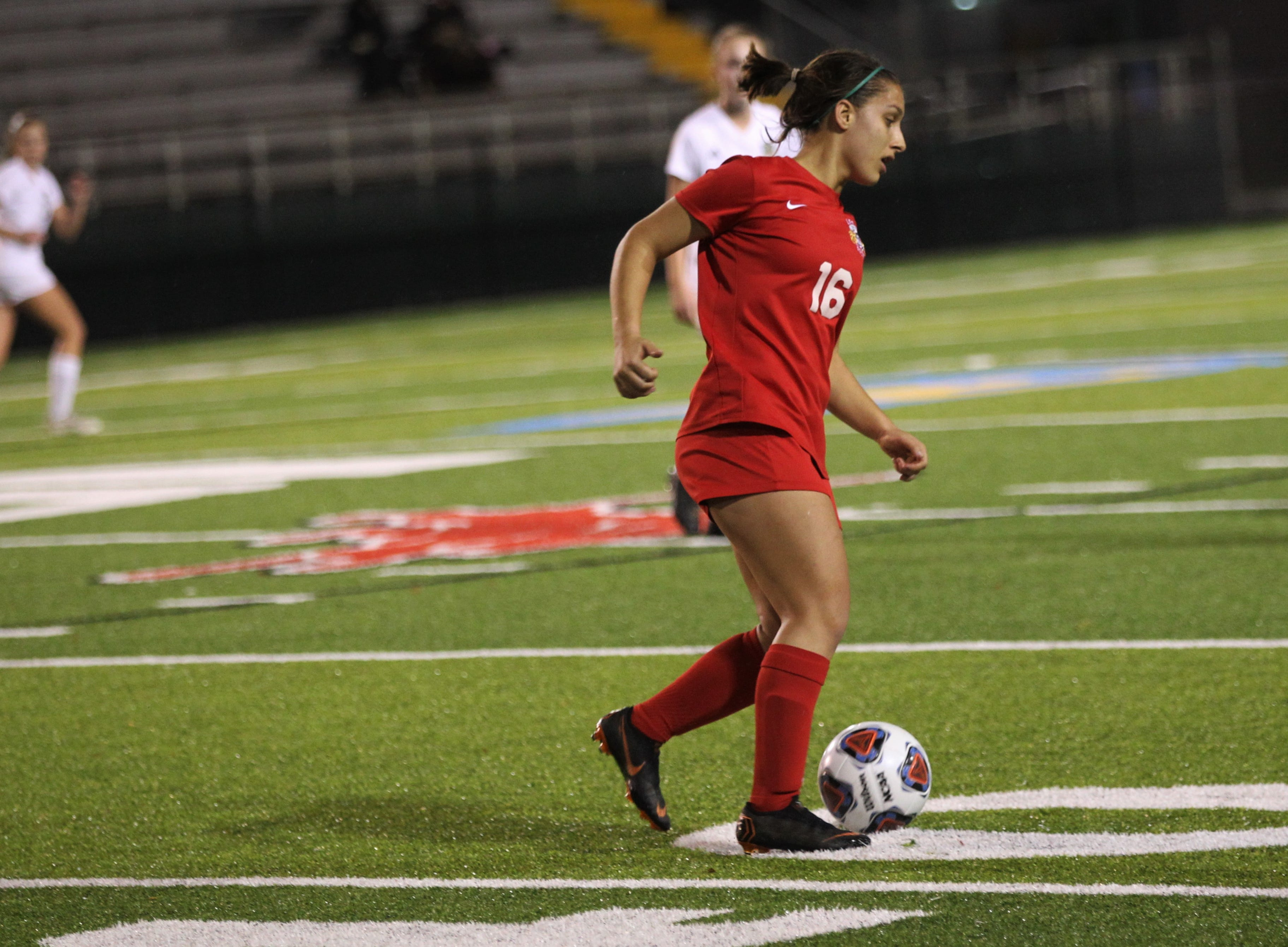 Leon's Eden Kirn dribbles in the midfield as Leon's girls soccer team beat Lincoln 2-1 in the District 2-4A championship at Gene Cox Stadium on Feb. 1, 2019.