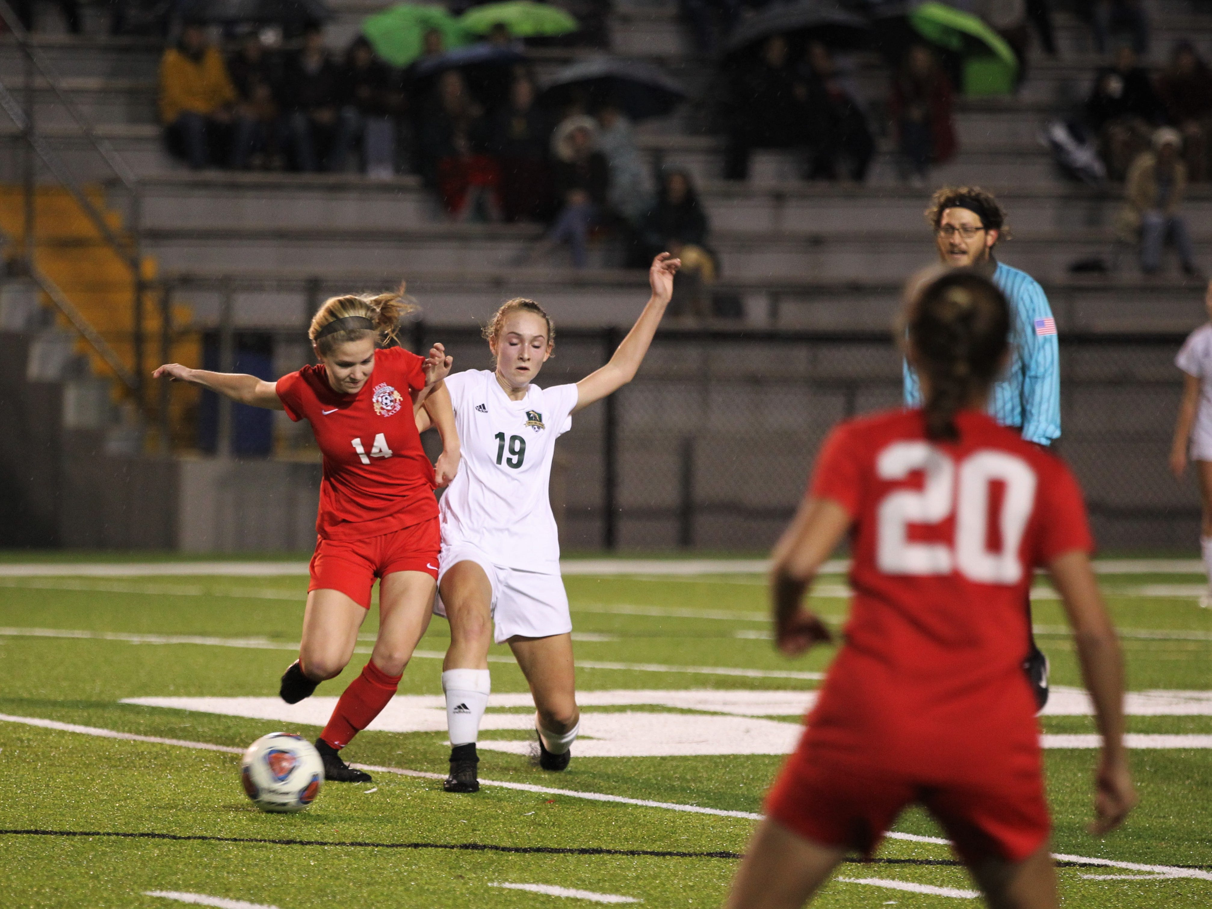Leon's Emma McGibany and Lincoln's Lexi Gray battle for possession as Leon's girls soccer team beat Lincoln in the District 2-4A championship on Feb. 1, 2019.