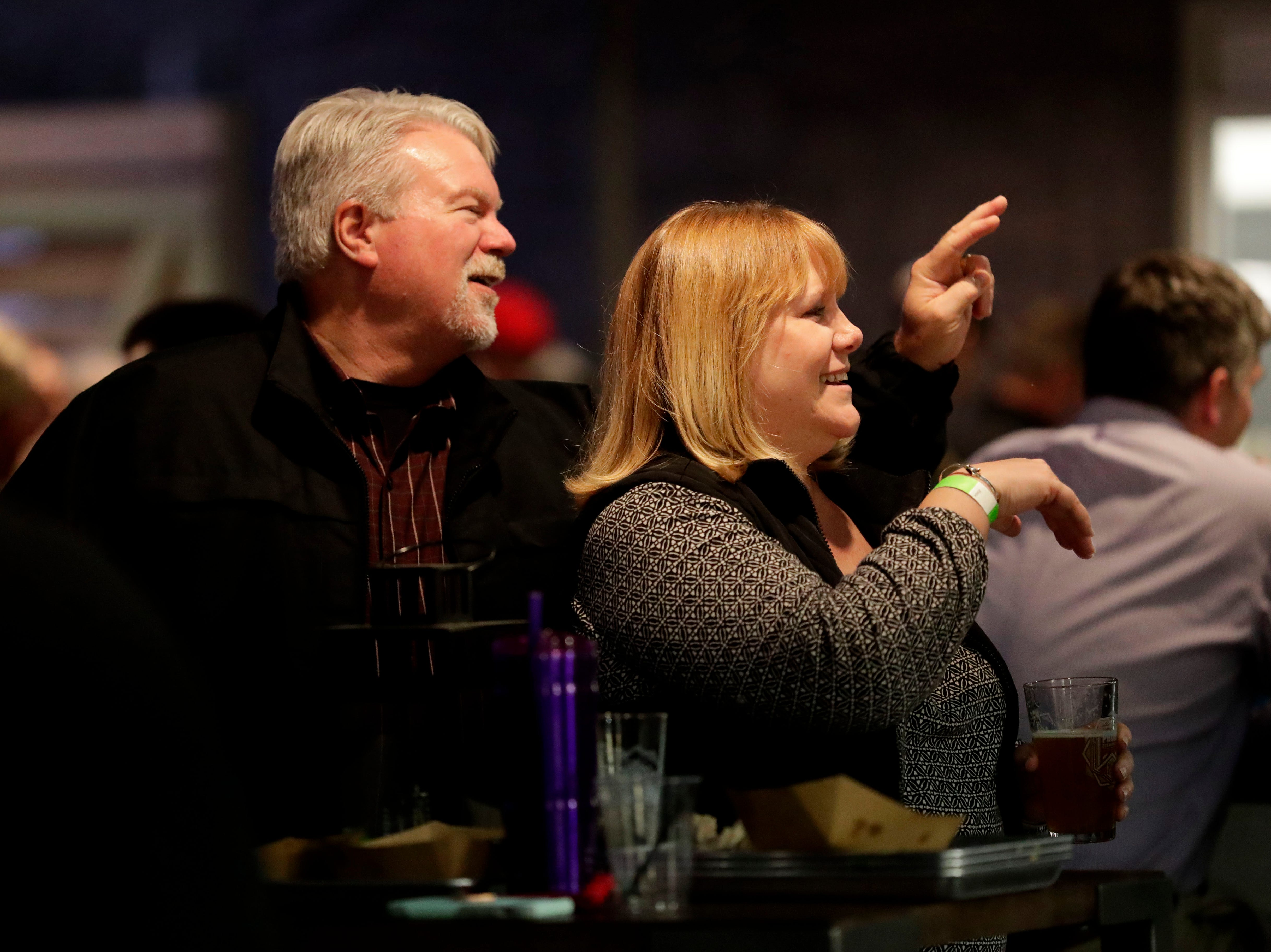 Paul Whitfield, left, and his wife, Stephanie Whitfield, wave to their friends while enjoying Proof Brewery's soft opening, Friday, Feb. 1, 2019.