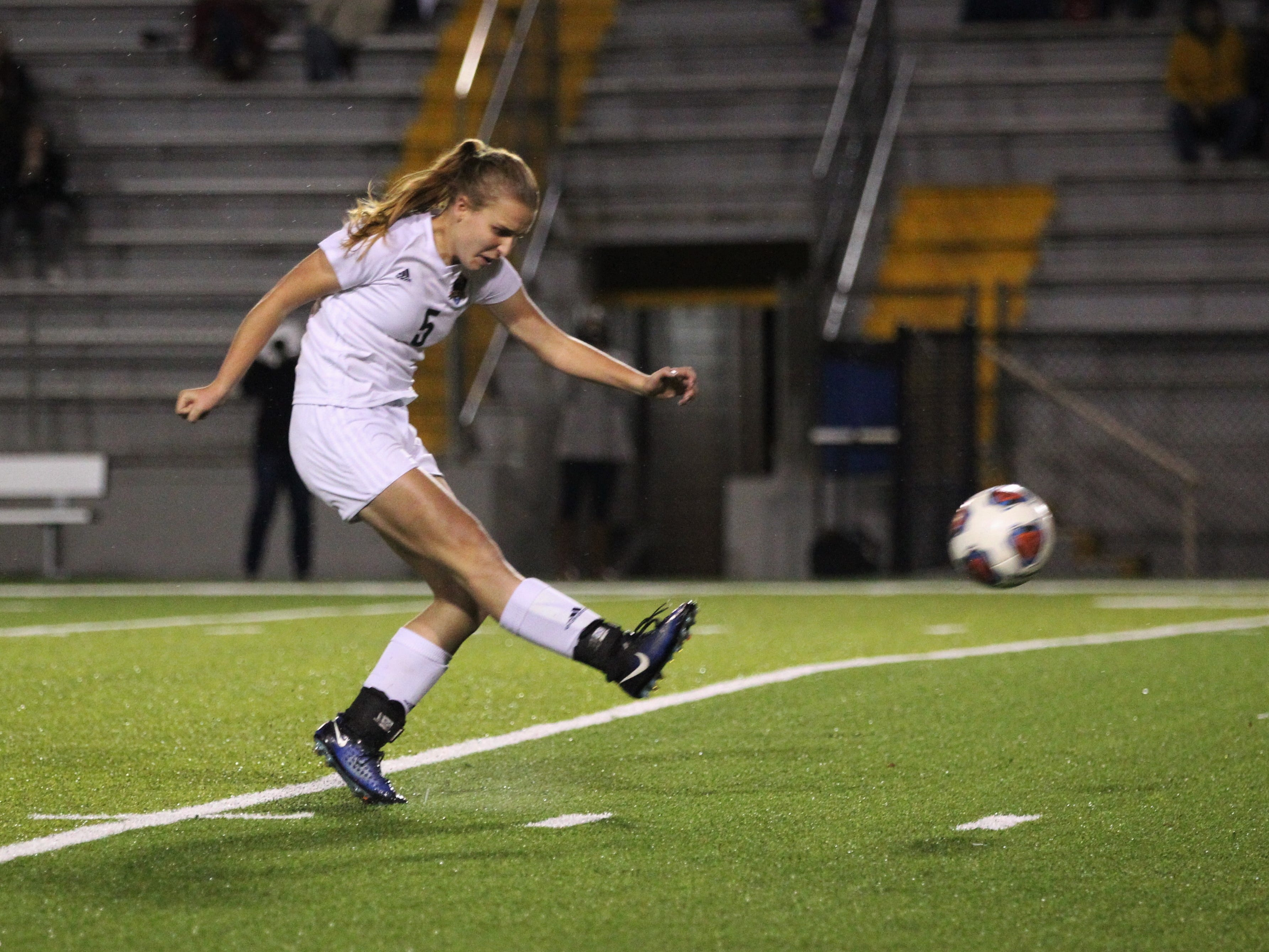 Lincoln senior Sarah Wnuk takes a free kick that would hit the crossbar as Leon's girls soccer team beat Lincoln 2-1 in the District 2-4A championship at Gene Cox Stadium on Feb. 1, 2019.