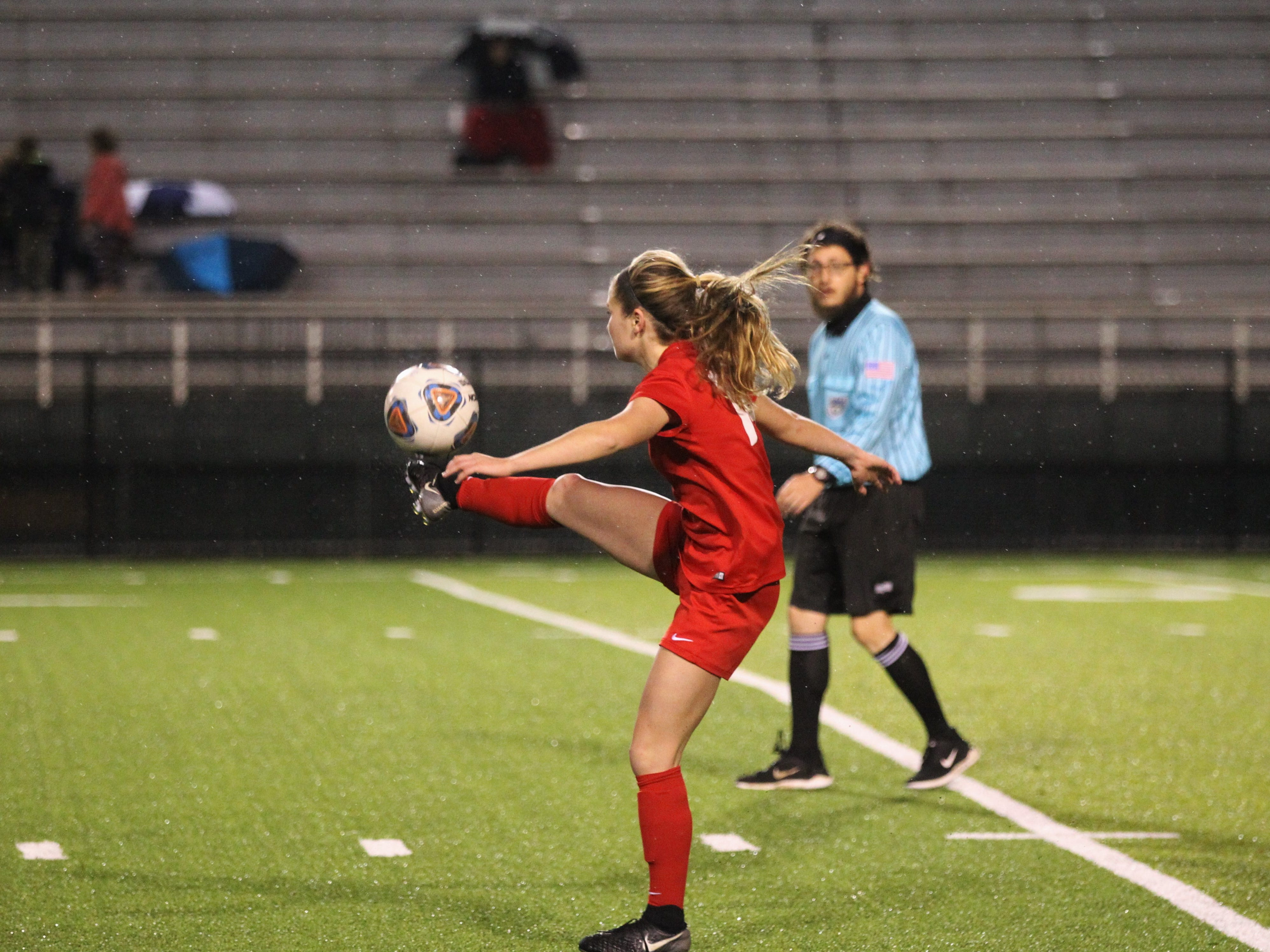 Leon's Emma McGibany plays a ball forward as Leon's girls soccer team beat Lincoln in the District 2-4A championship on Feb. 1, 2019.