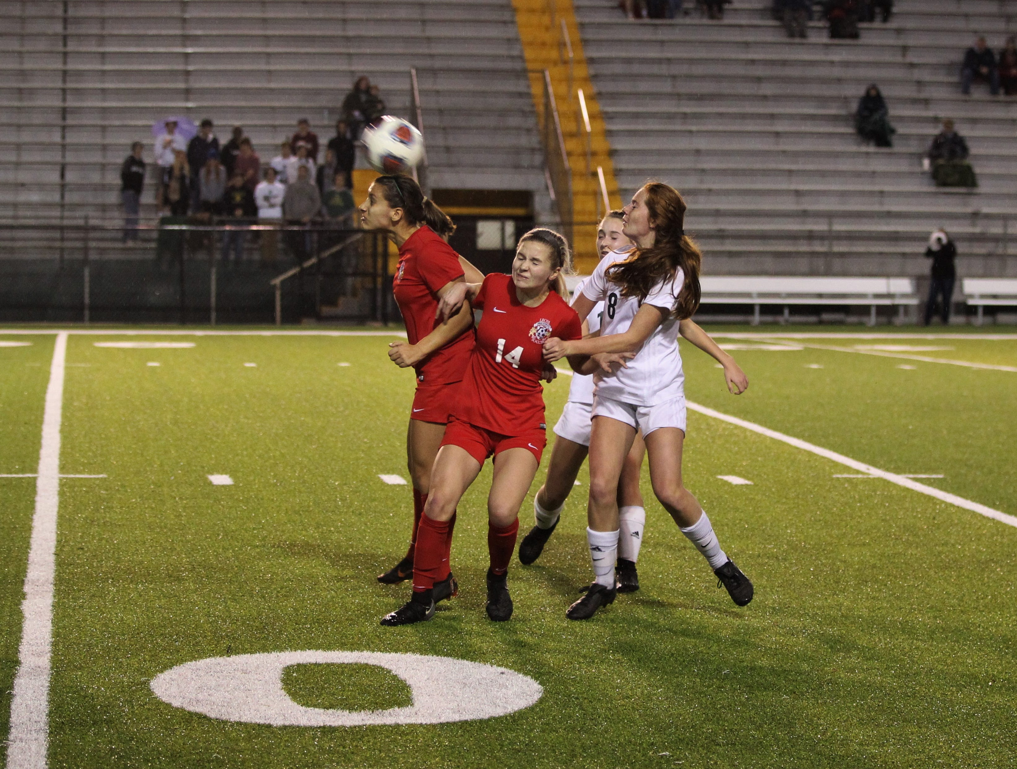 Leon's Eden Kirn flicks a header in traffic as Leon's girls soccer team beat Lincoln 2-1 in the District 2-4A championship at Gene Cox Stadium on Feb. 1, 2019.