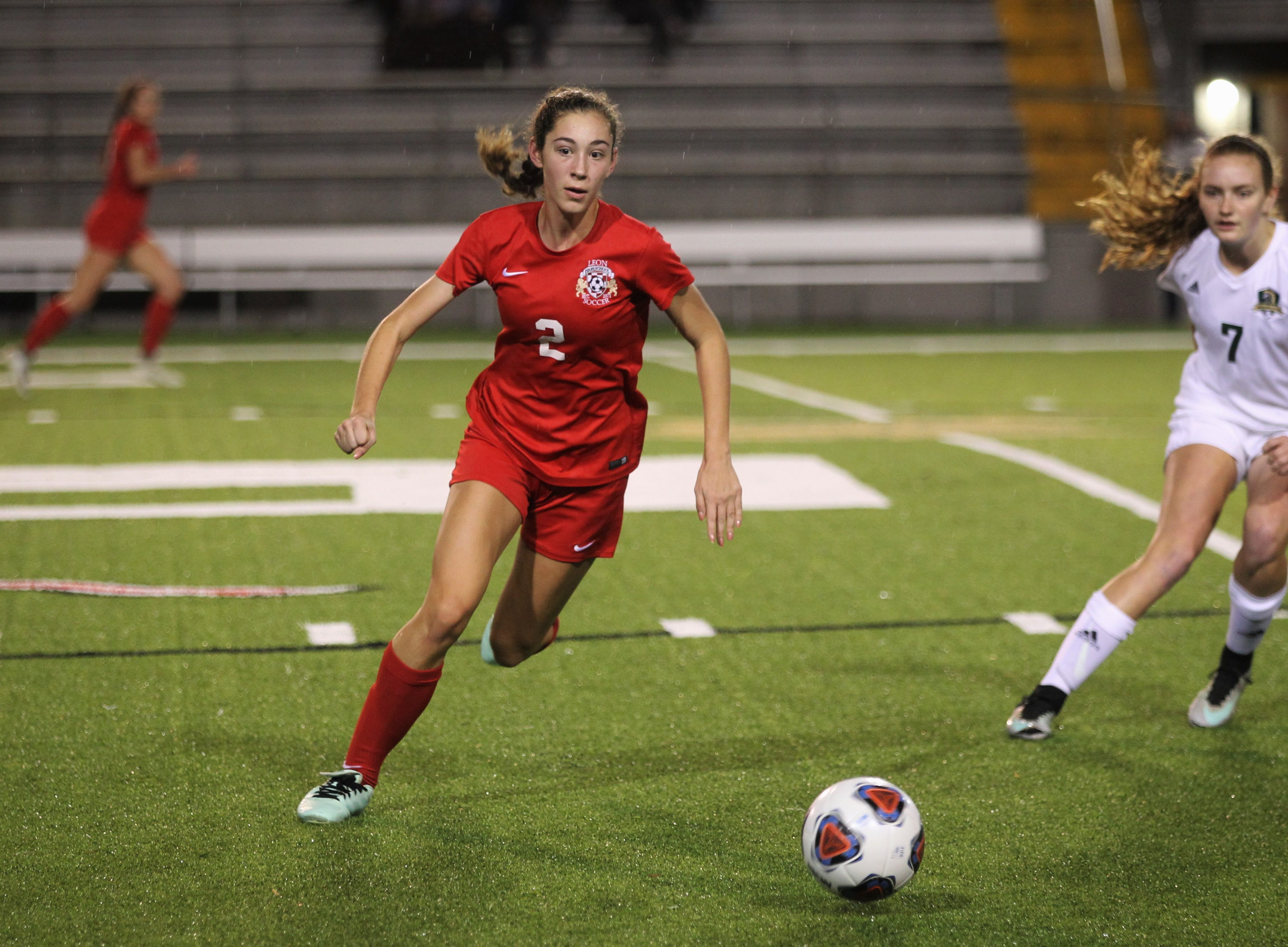 Leon's Melody Hughes races to get control of a free ball as Leon's girls soccer team beat Lincoln in the District 2-4A championship on Feb. 1, 2019.